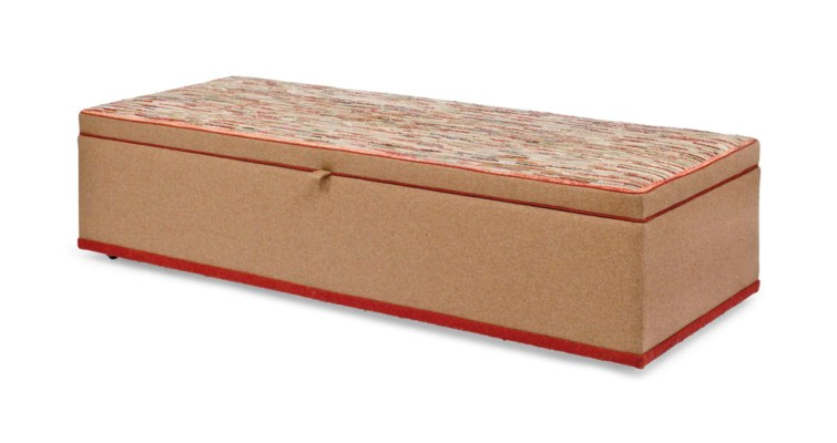 AN OTTOMAN COVERED WITH AN AME