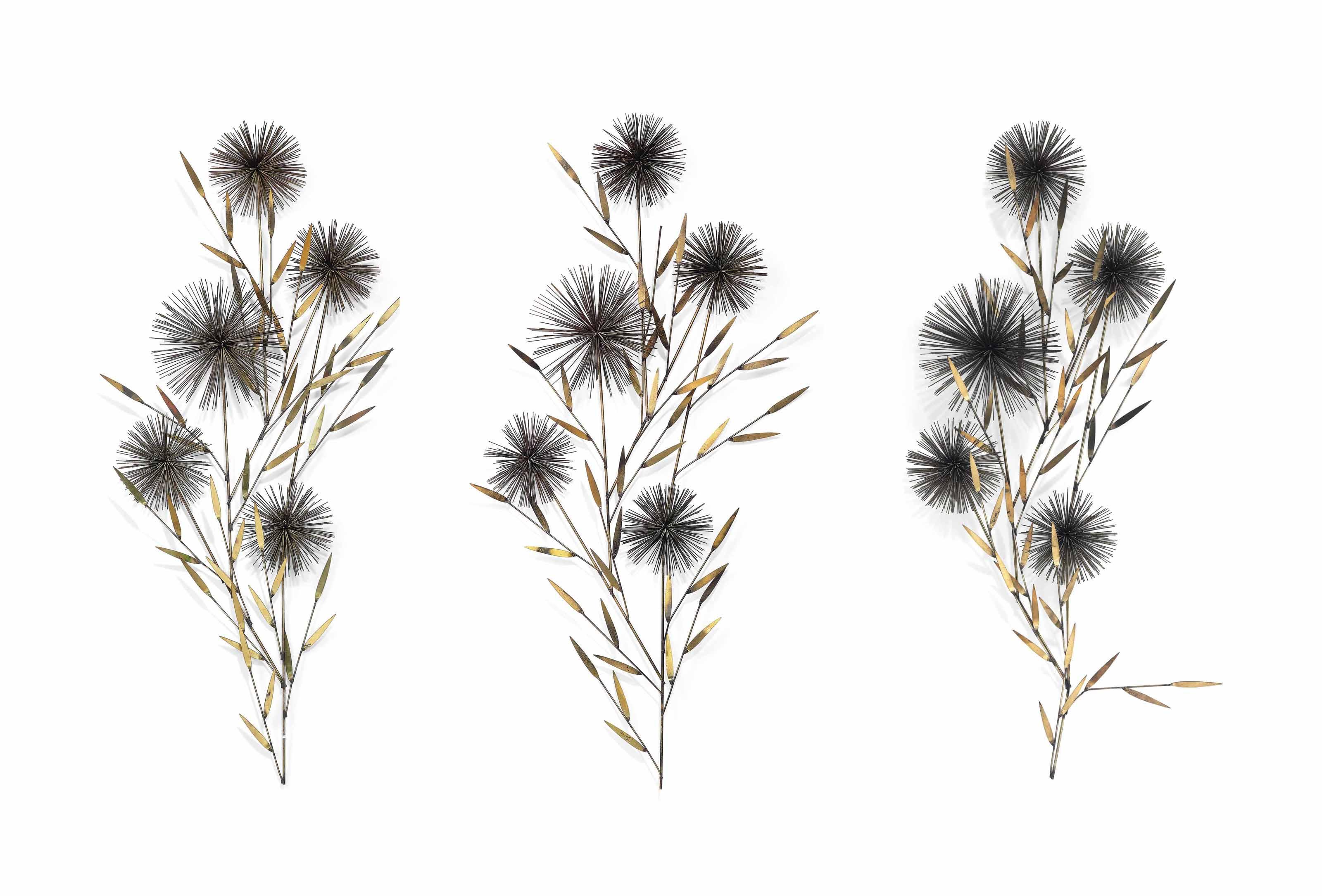 A SET OF THREE GILT-METAL 'FLOWER' WALL SCULPTURES