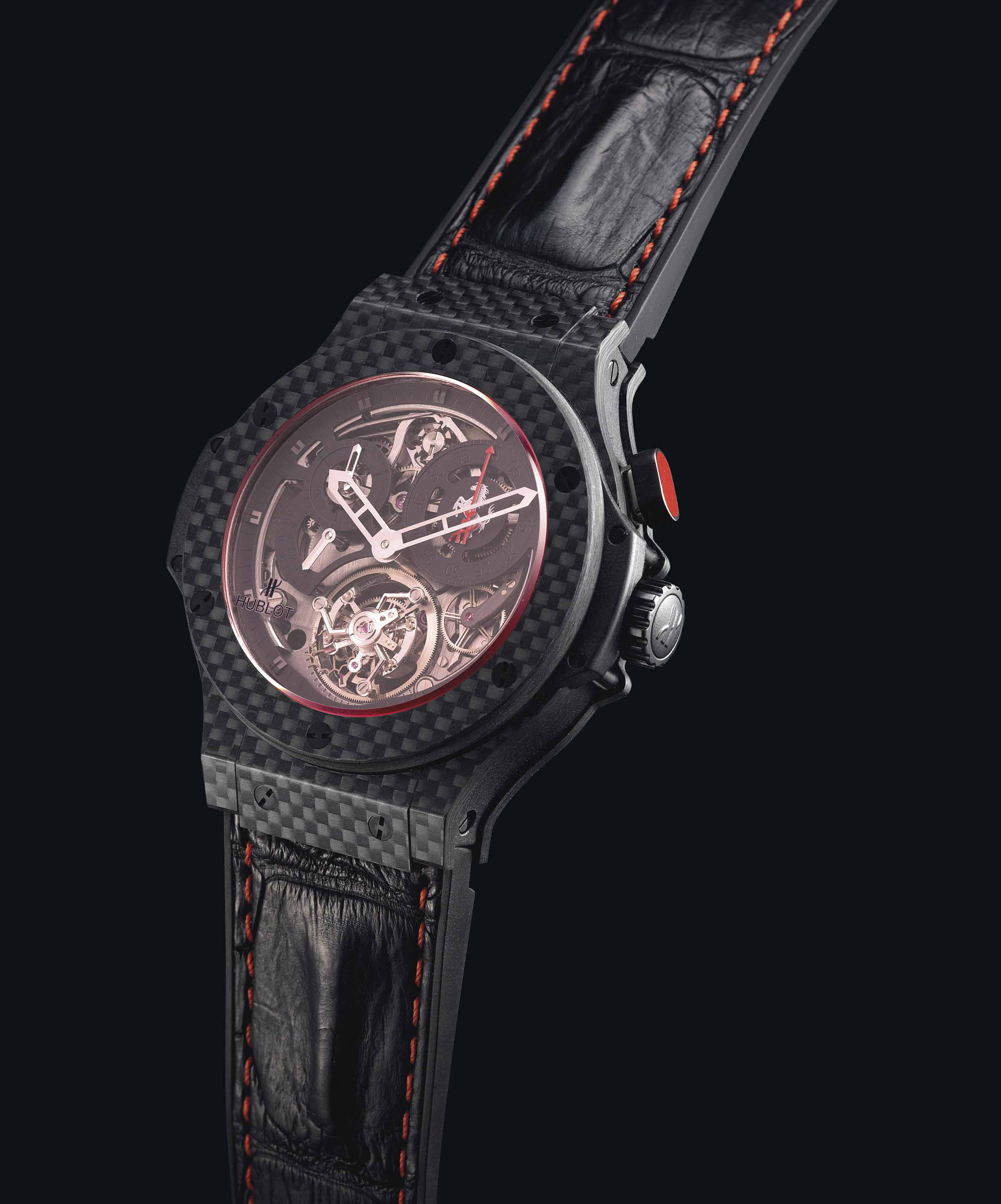 HUBLOT. A FINE AND VERY RARE CARBON FIBRE AND TITANIUM LIMITED EDITION SEMI-SKELETONISED SINGLE BUTTON CHRONOGRAPH TOURBILLON WRISTWATCH WITH 5 DAY POWER RESERVE, MADE FOR 20TH ANNIVERSARY OF THE FIRST FERRARI IN CHINA
