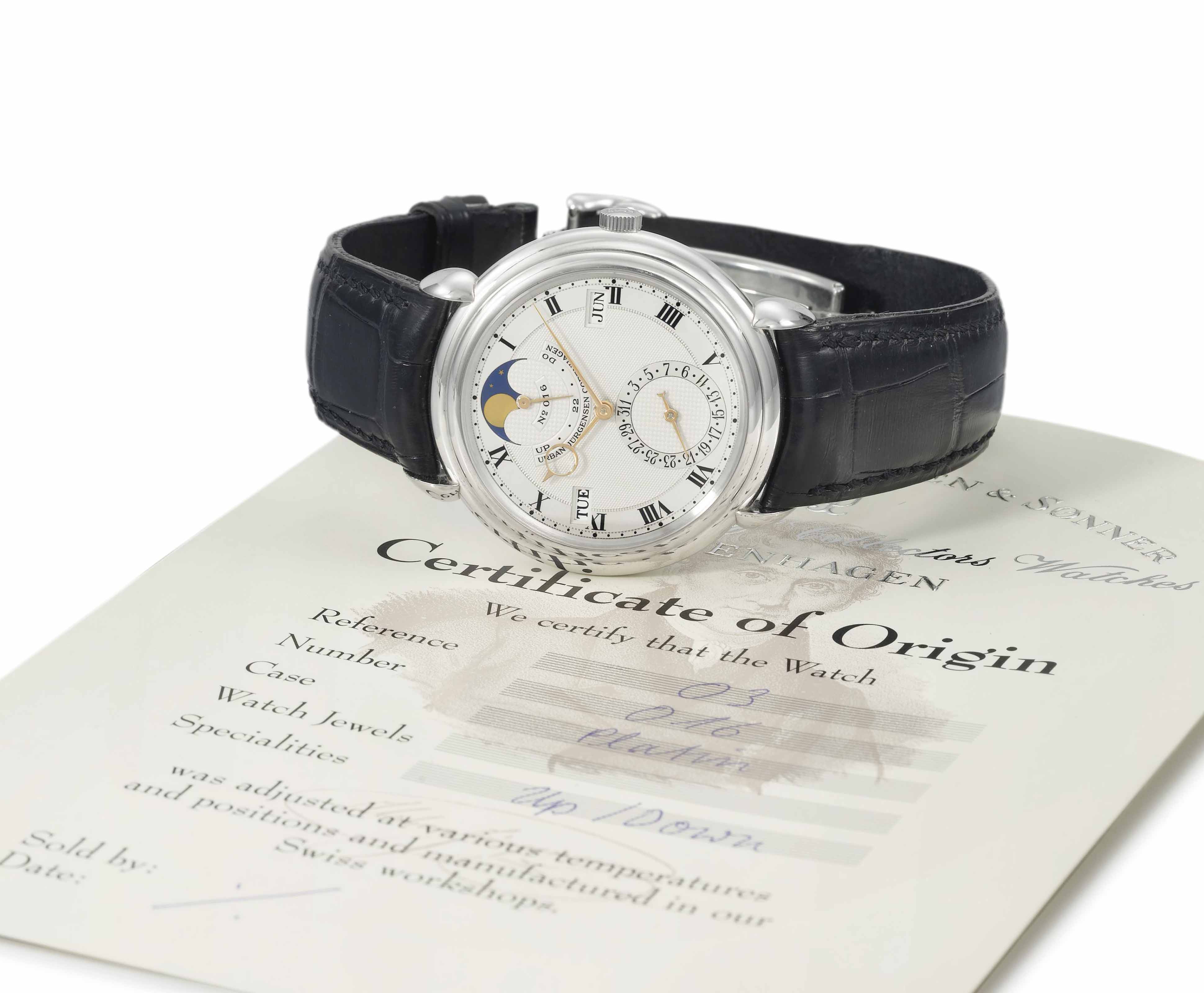 Urban Jürgensen. A fine and rare platinum automatic perpetual calendar wristwatch with moon phases and up and down indicator, original certificate and box