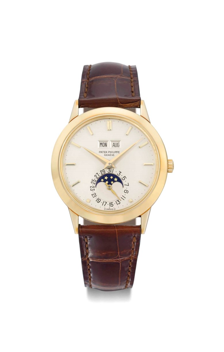 Patek Philippe. A very fine, extremely rare and historically important 18K gold automatic perpetual calendar wristwatch with moon phases, Signed Patek Philippe, Genève, ref. 3450, movement no. 1119586, case no. 2788611, manufactured in 1981. 37.5  mm  diam. Sold for CHF 287,000 on 12 May 2014  at Christie's in Geneva