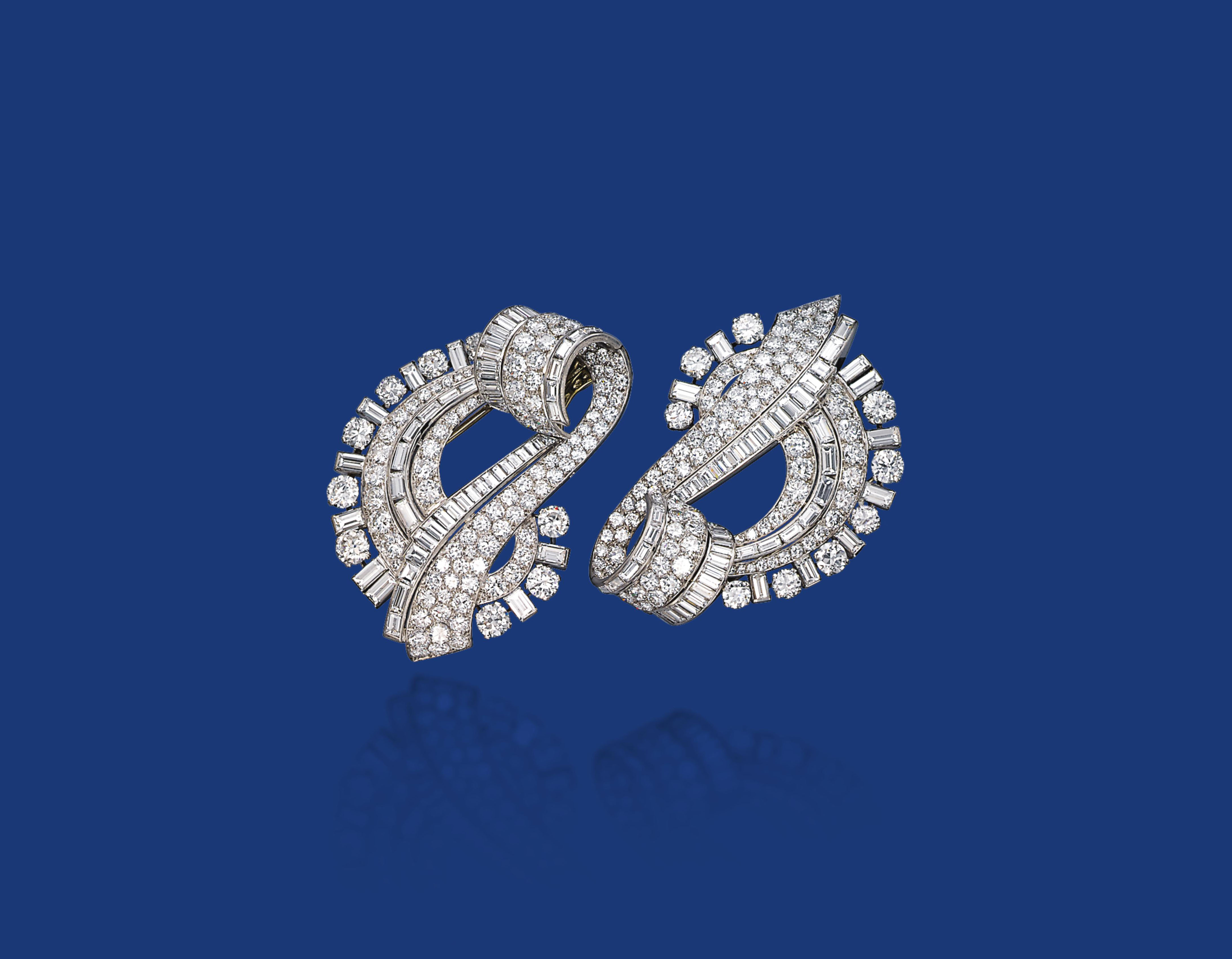 A PAIR OF DIAMOND CLIP BROOCHES, BY OSTERTAG