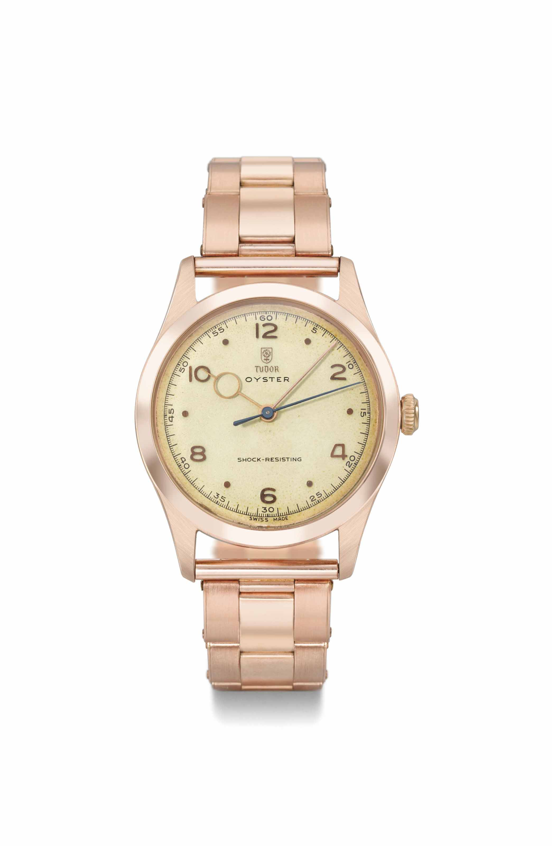 Tudor. A very rare and attractive 14K pink gold tonneau-shaped wristwatch with bracelet