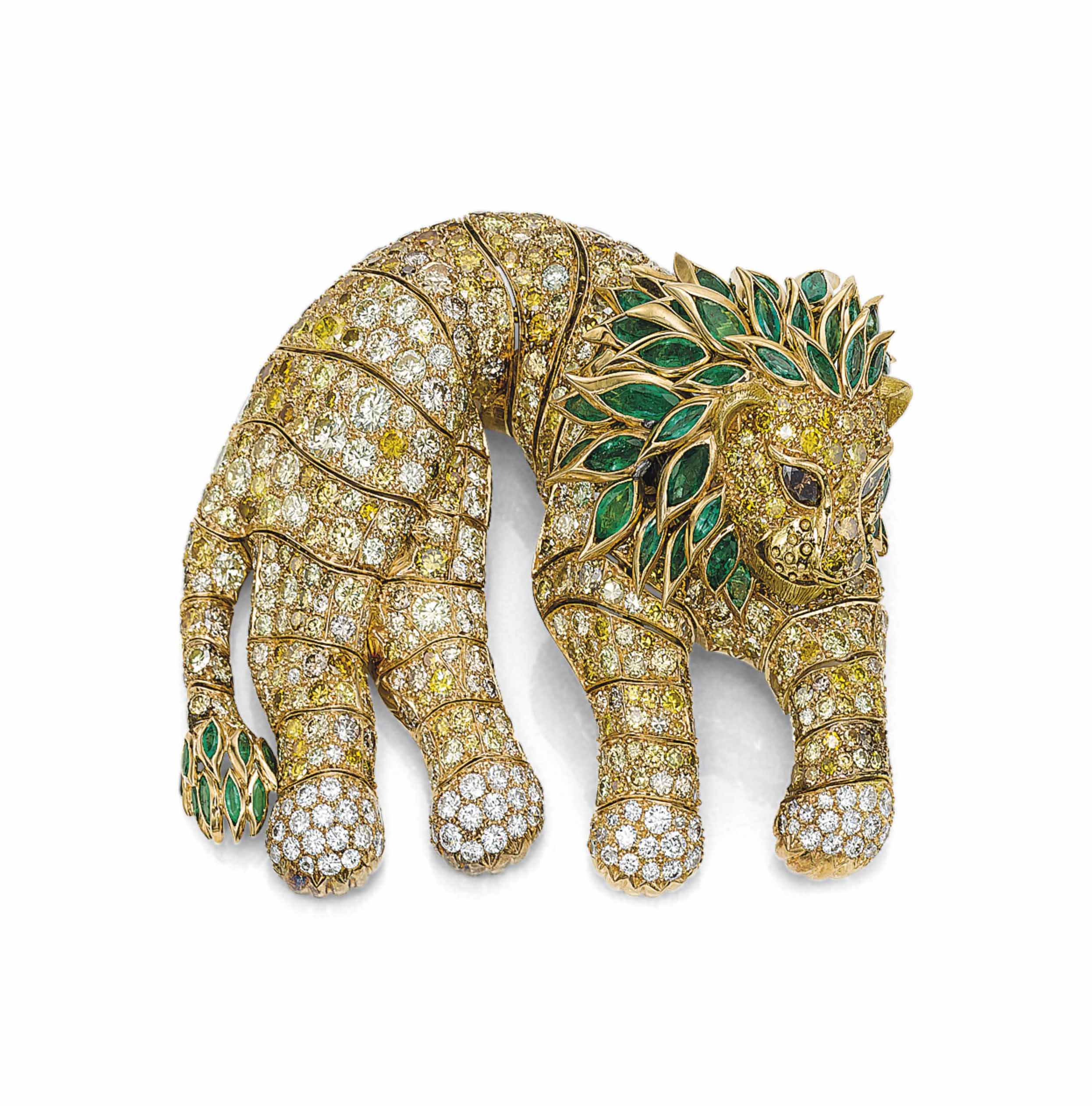 A COLOURED DIAMOND, DIAMOND AND EMERALD LION SHOULDER BROOCH, BY RENÉ BOIVIN