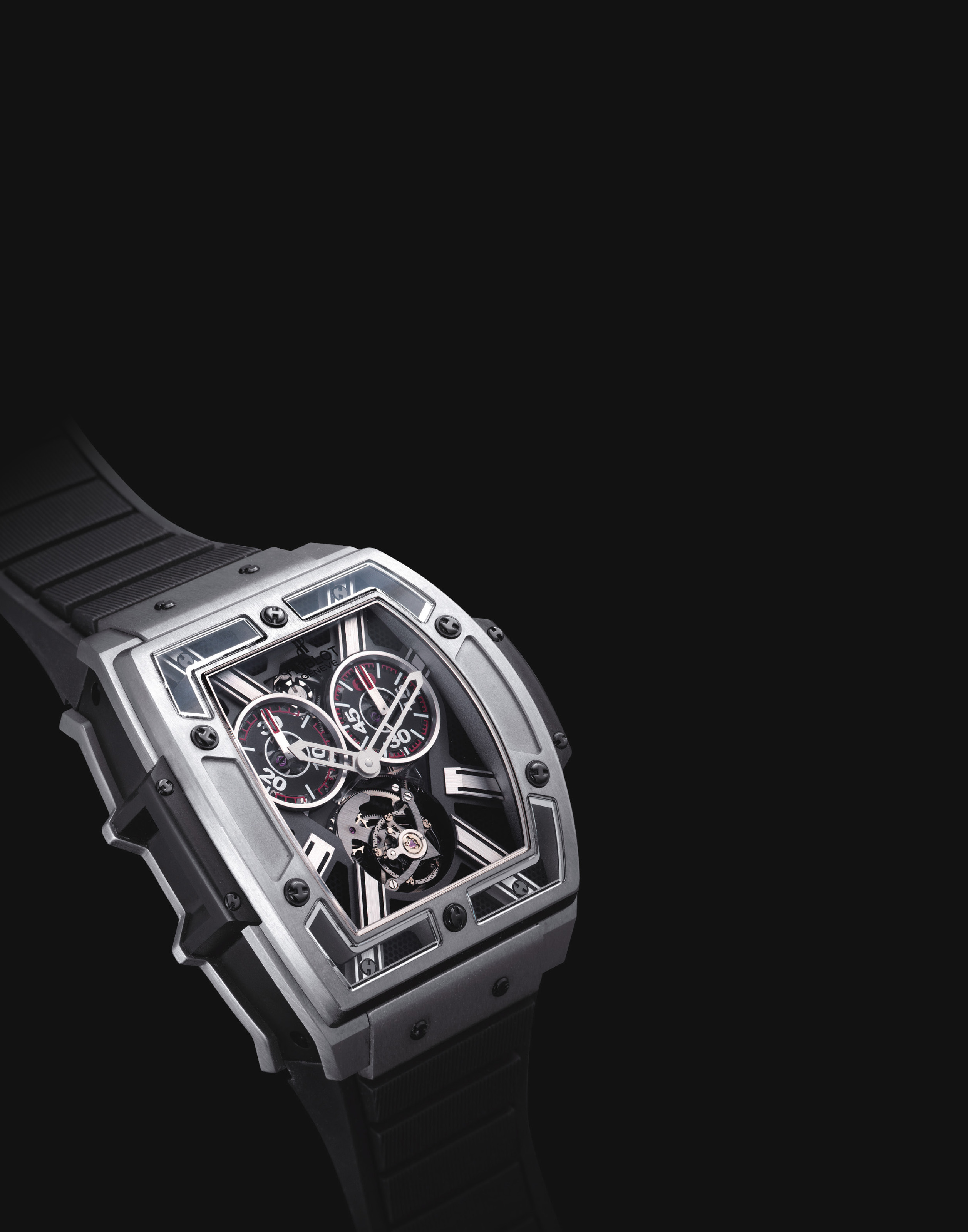 HUBLOT. A RARE AND OVERSIZED TITANIUM LIMITED EDITION TONNEAU-SHAPED SEMI-SKELETONISED SINGLE BUTTON CHRONOGRAPH TOURBILLON WRISTWATCH