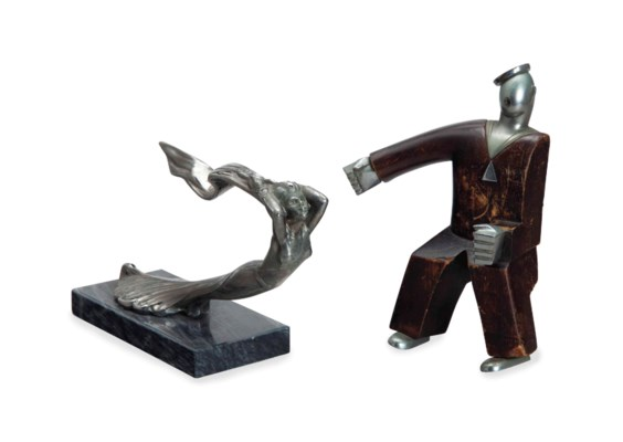A CHROMED METAL AND WOOD FIGUR