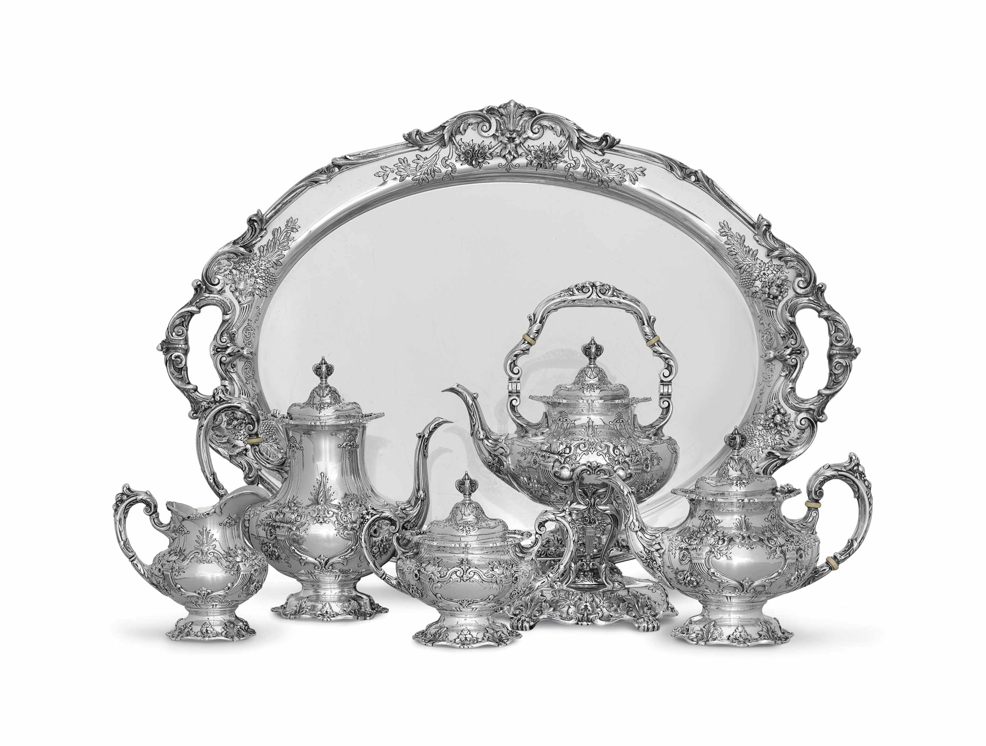 A SILVER FIVE-PIECE TEA AND COFFEE SERVICE WITH TRAY**