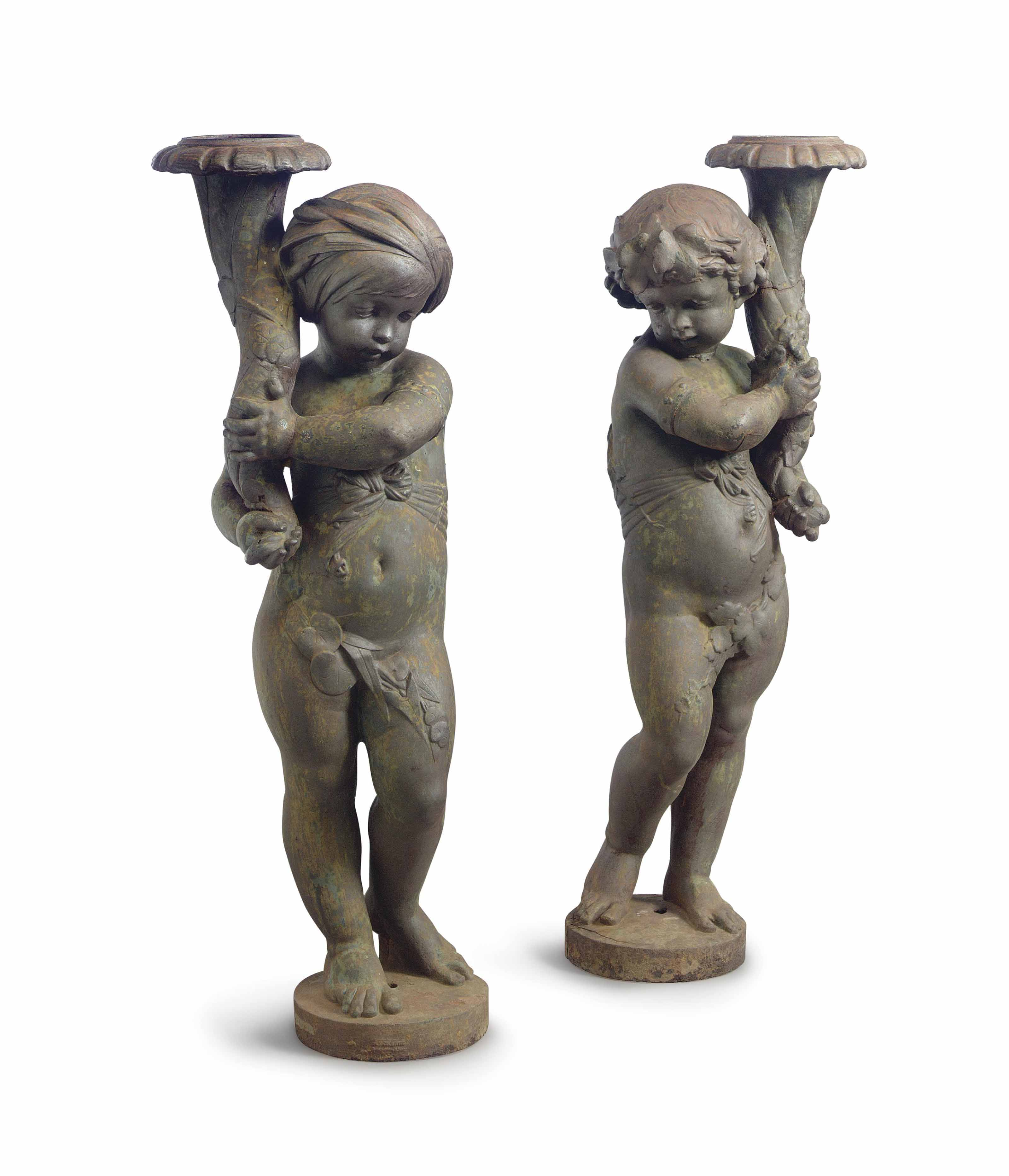 A PAIR OF FRENCH CAST-IRON FIGURAL TORCHERES,
