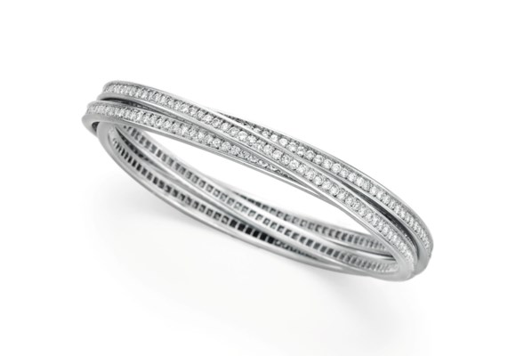 "A DIAMOND AND WHITE GOLD ""TRINITY"" BANGLE BRACELET BY CARTIER"