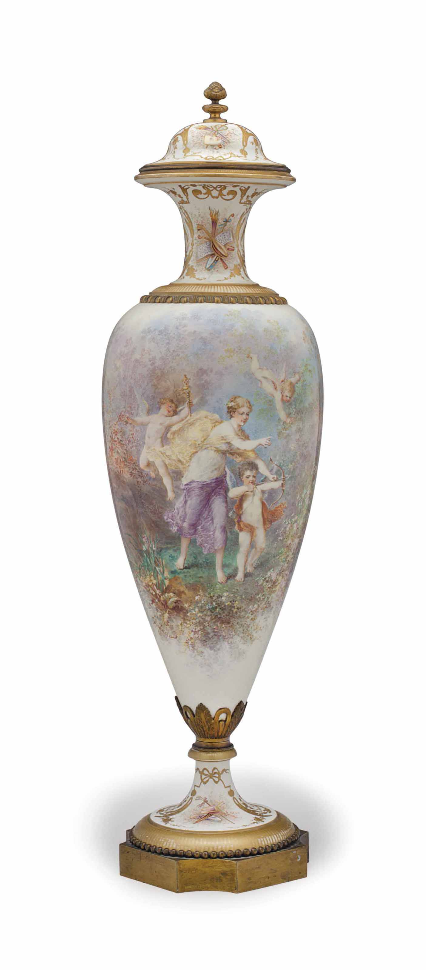 AN ORMOLU-MOUNTED SEVRES STYLE WHITE-GROUND VASE AND COVER
