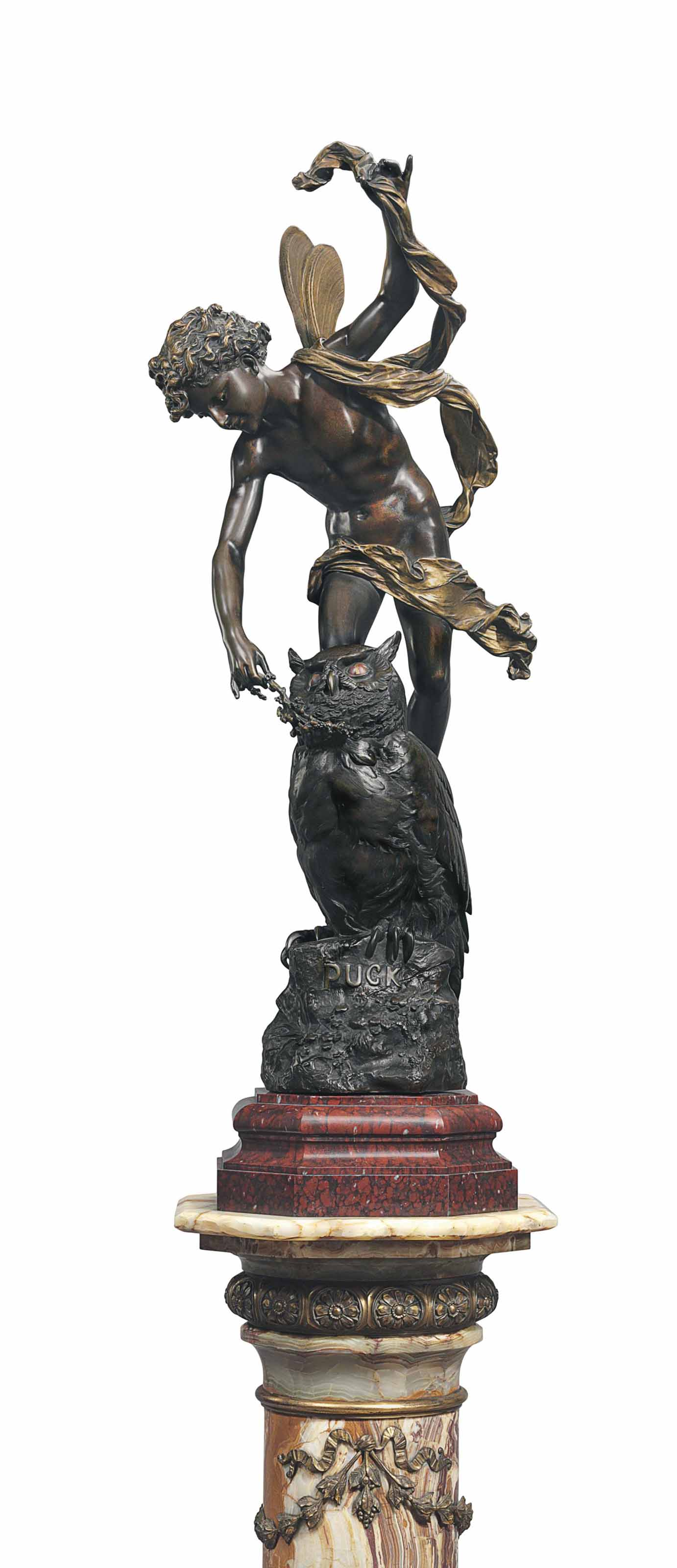 A FRENCH PARCEL-GILT AND PATINATED BRONZE FIGURAL GROUP OF PUCK, ON PEDESTAL