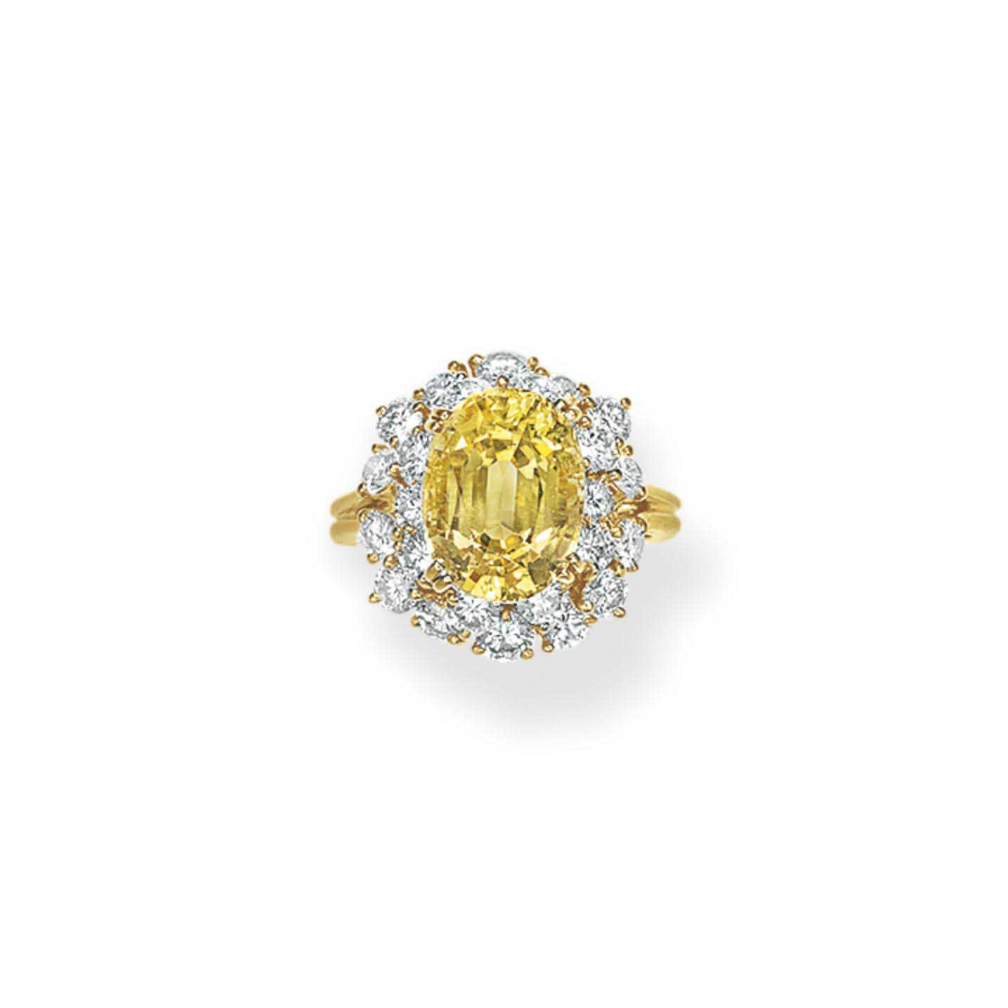 A YELLOW SAPPHIRE AND DIAMOND RING, BY JULIUS COHEN