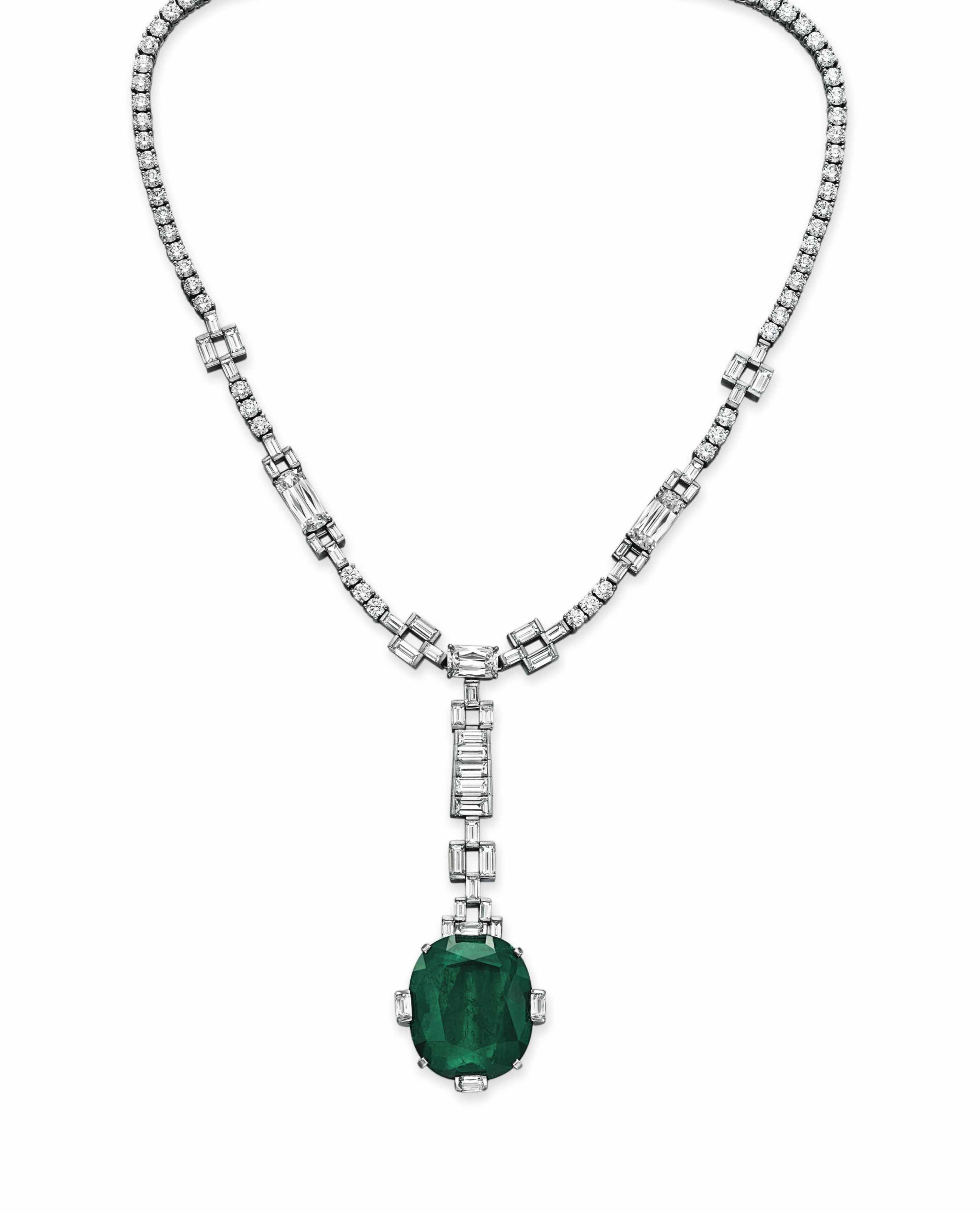 AN EMERALD AND DIAMOND PENDANT NECKLACE, BY WILLIAM GOLDBERG