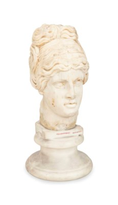 A CARVED MARBLE HEAD OF VENUS,