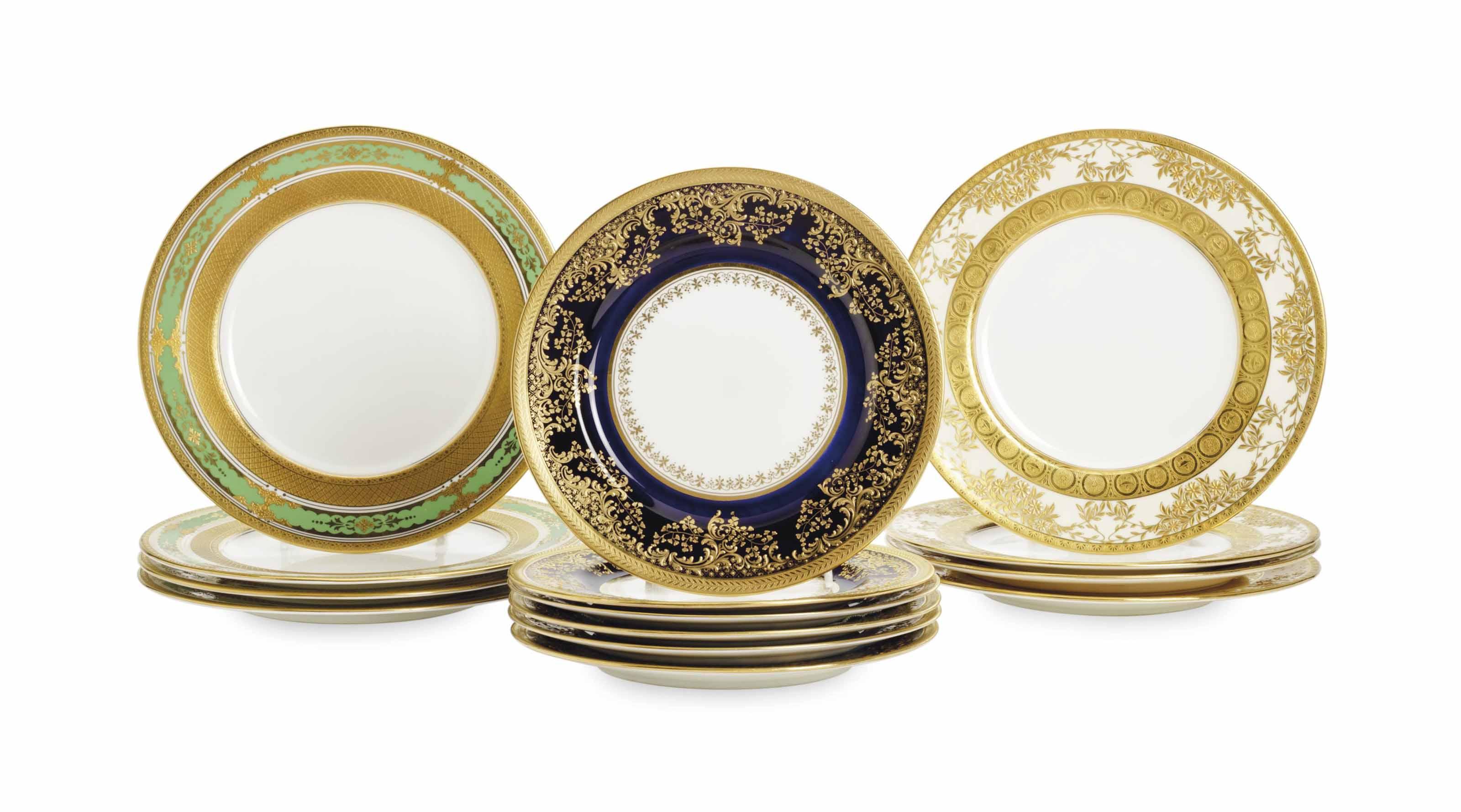 THREE SETS OF ENGLISH GILT DECORATED PLATES,