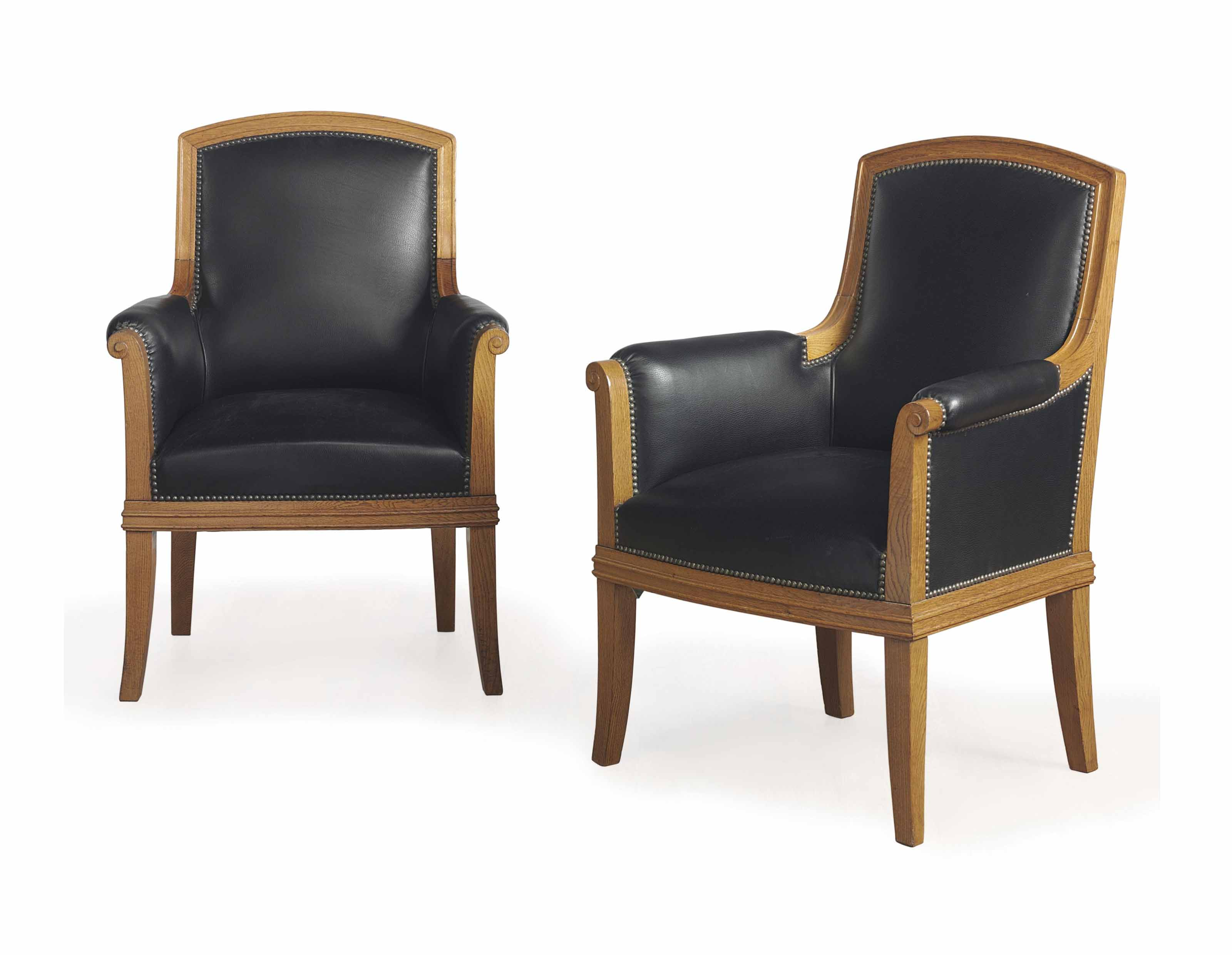 A PAIR OF FRENCH OAK AND LEATHER UPHOLSTERED ARMCHAIRS,