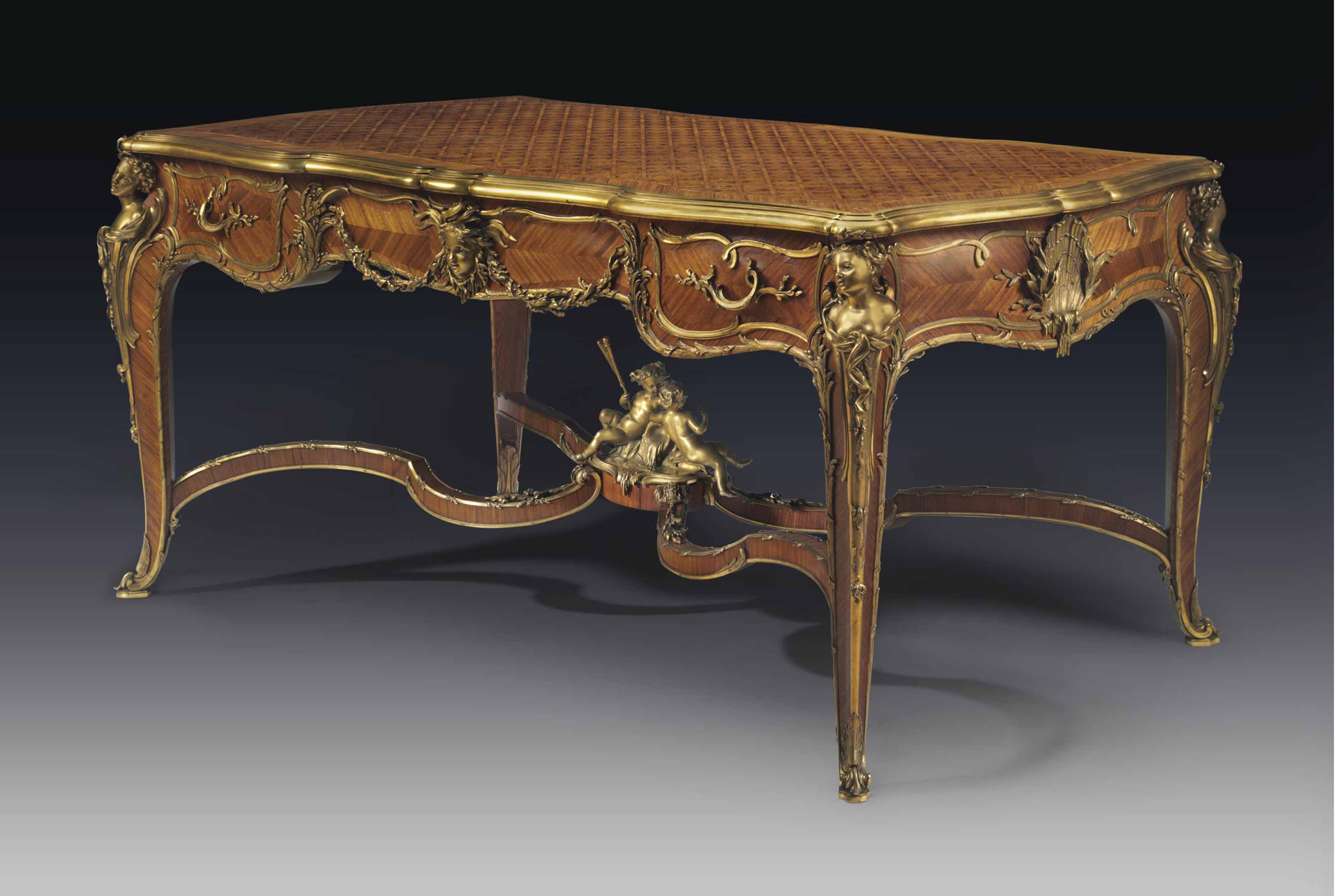 A FINE FRENCH ORMOLU-MOUNTED KINGWOOD AND SATINE PARQUETRY CENTER-TABLE