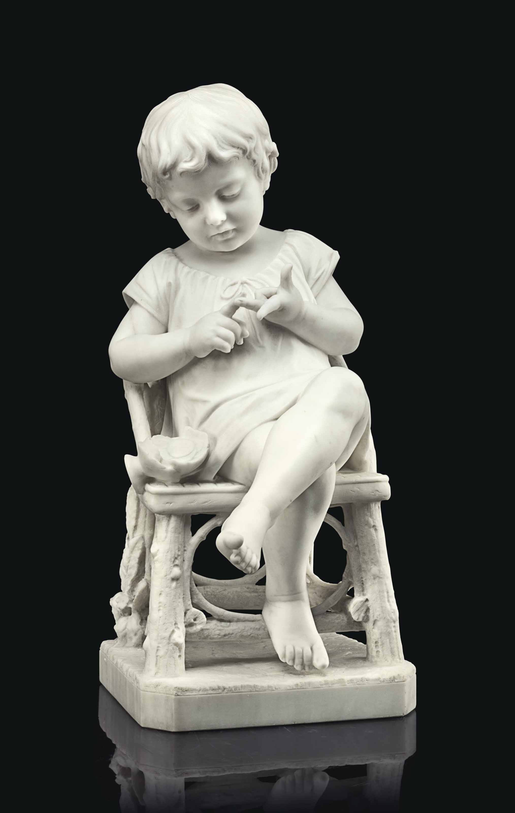 AN ITALIAN WHITE MARBLE FIGURE OF A CHILD COUNTING COINS