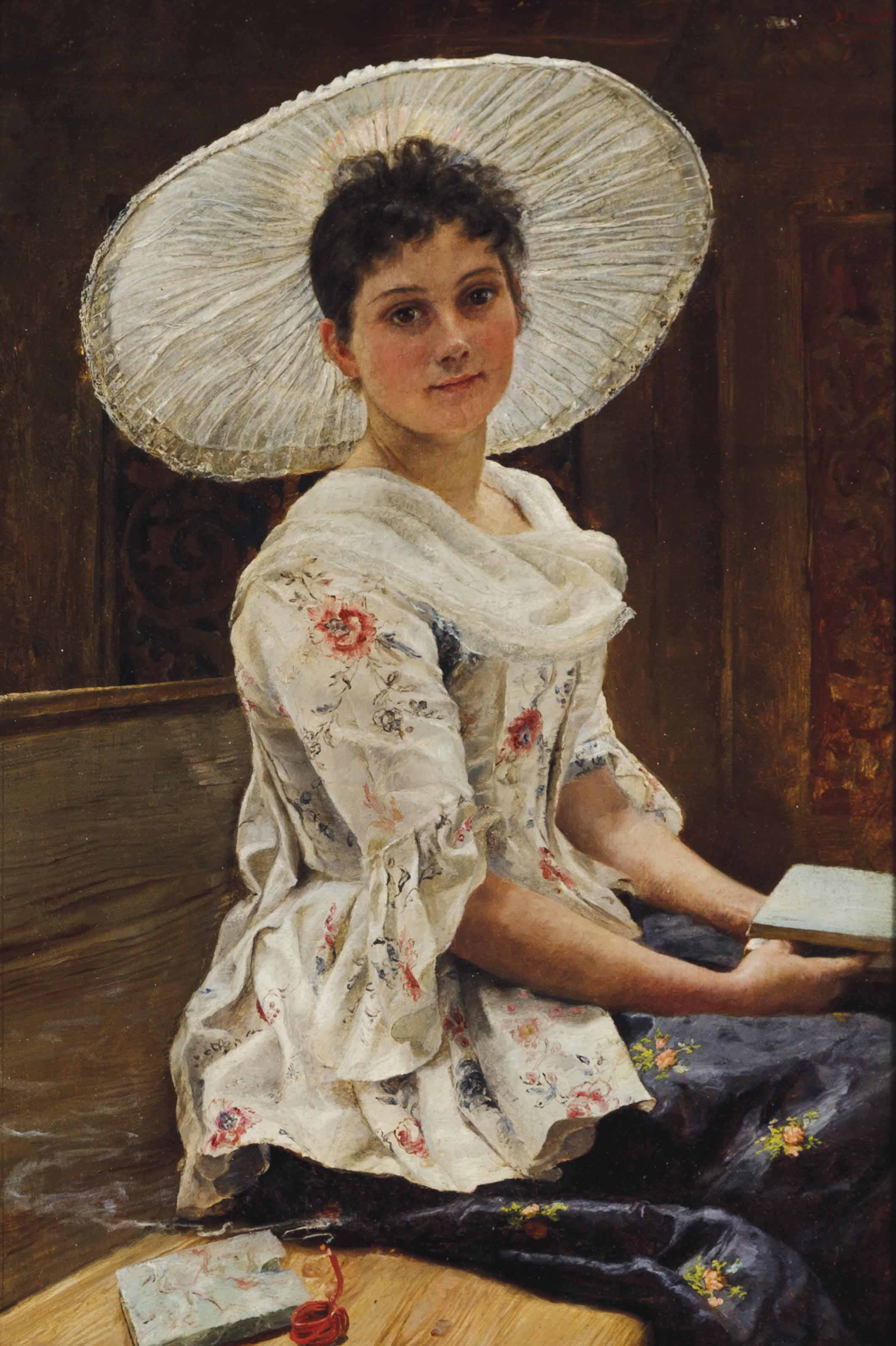 Young beauty in a white hat