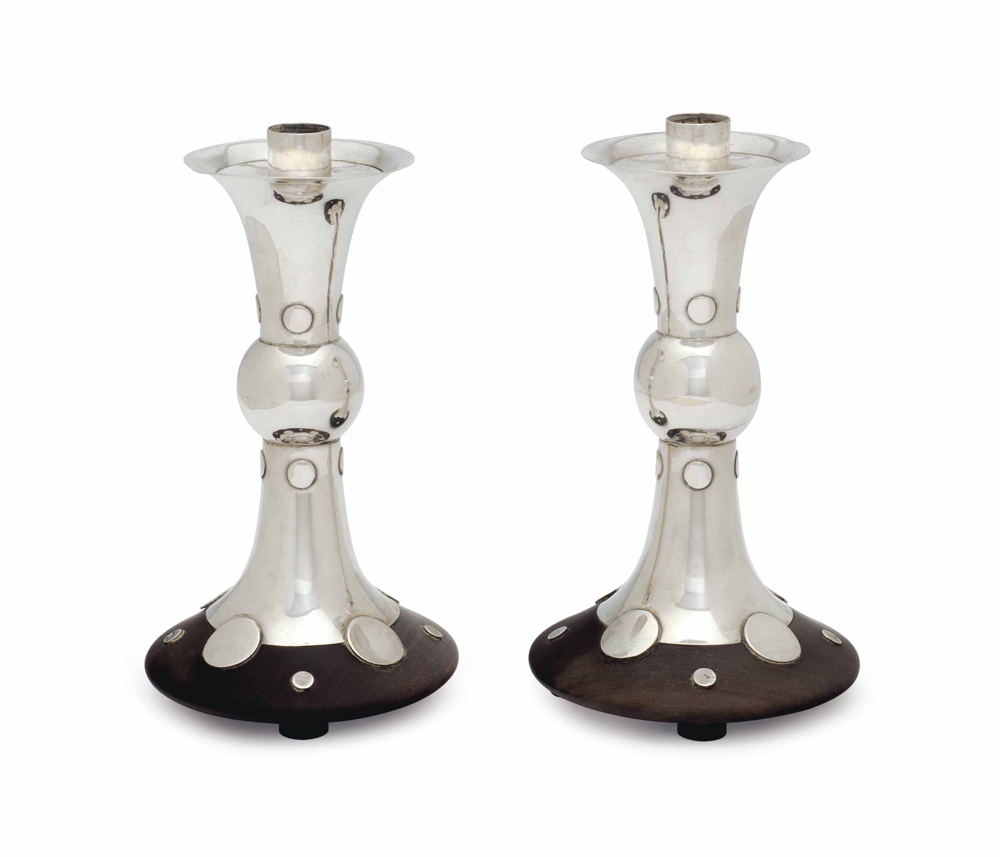 A PAIR OF MEXICAN WOOD AND SILVER CANDLESTICKS