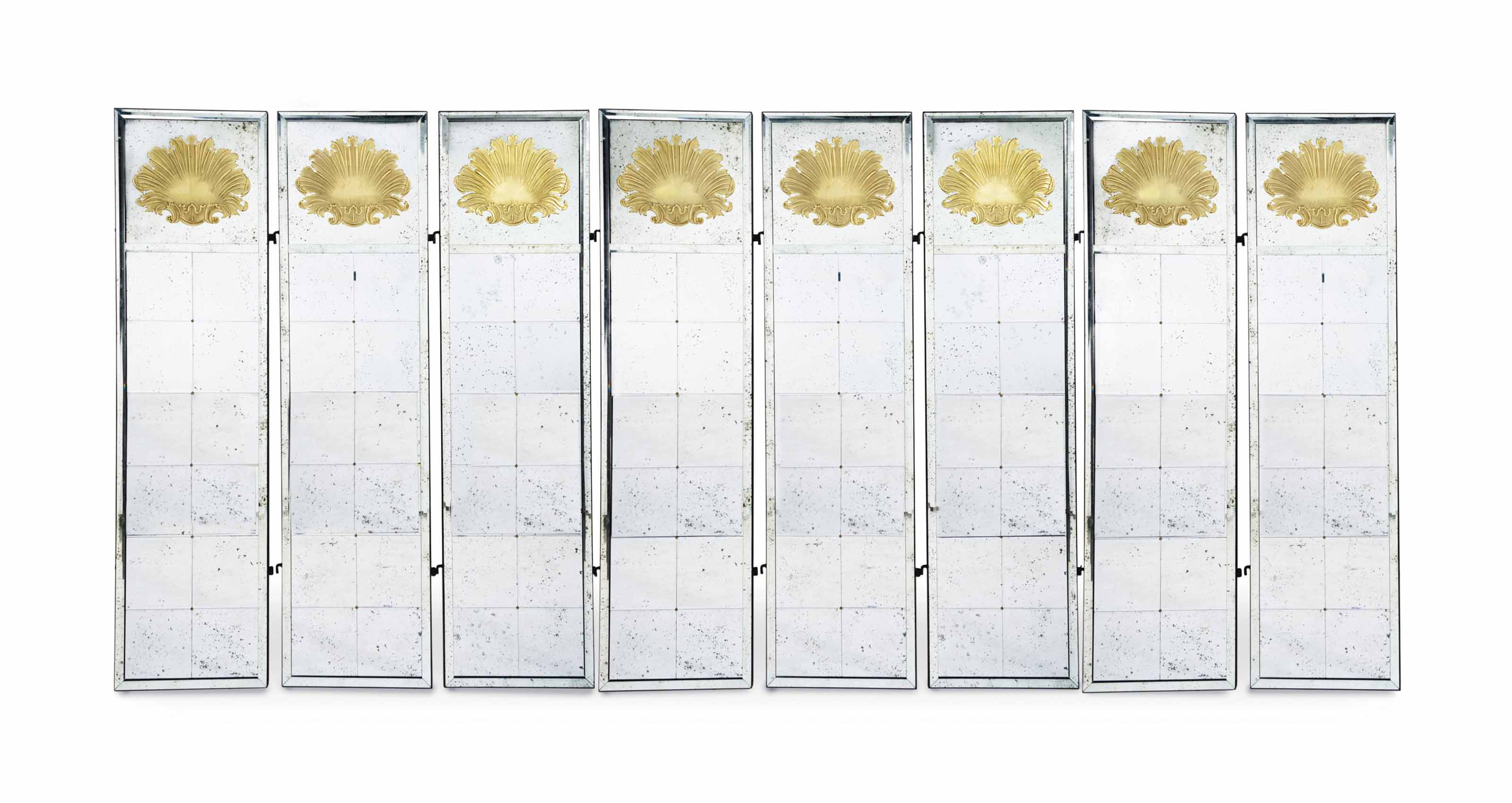A GILT-DECORATED MIRROR GLASS EIGHT PANEL FLOOR SCREEN