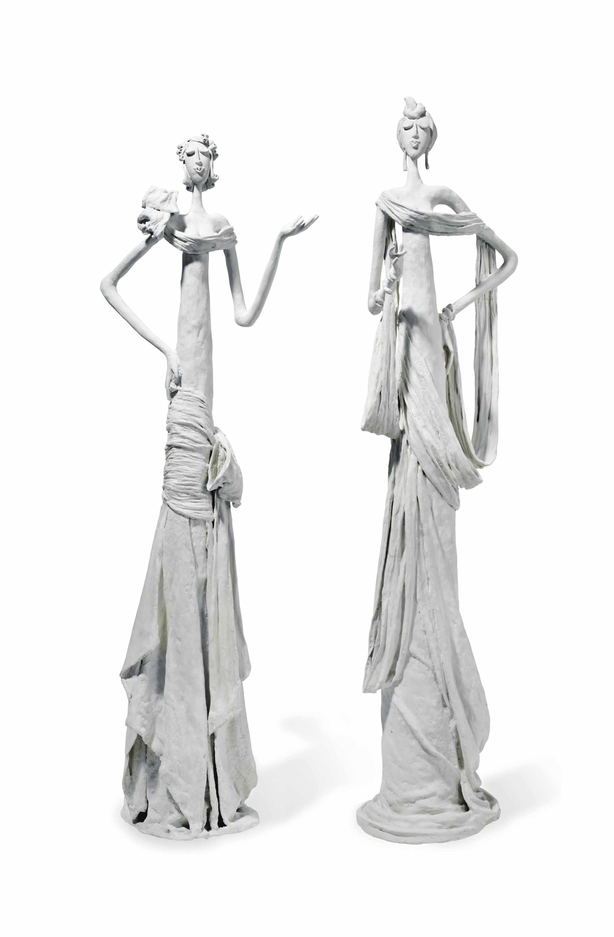 A PAIR OF PLASTER FIGURES OF WOMEN