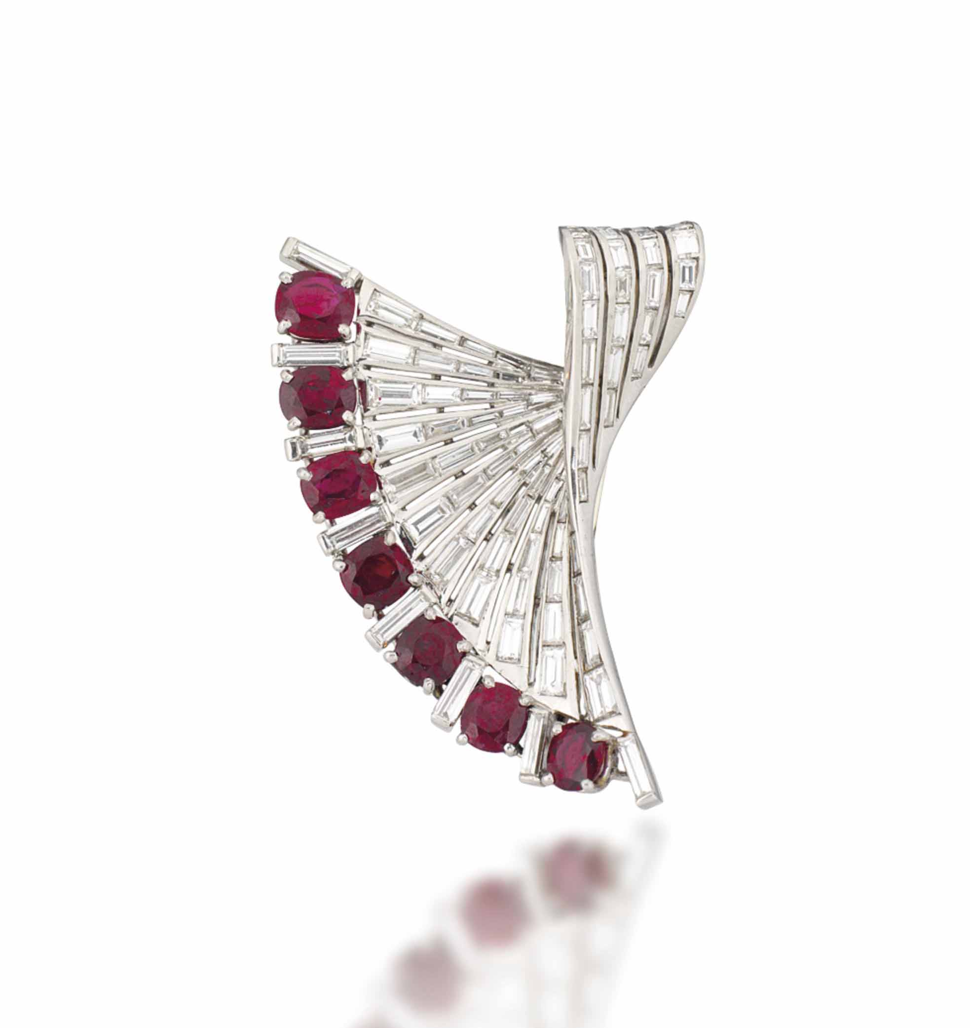 A RUBY AND DIAMOND BROOCH, BY STERLE