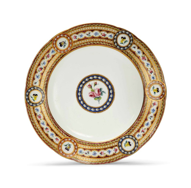 A Sèvres plate from the 'Service de la Reine' made for the Comte and Comtesse dArtois (assiette unie), 1789, blue interlaced L marks enclosing date letters MM, painter's P7 mark for Jean-Jacques Pierre, gilt dotted circle mark for Boileau le Jeune or Cadet, incised 24. 9⅜  in (24.3  cm)  diam. Sold for £5,625 on 2-3 June 2015  at Christie's in London