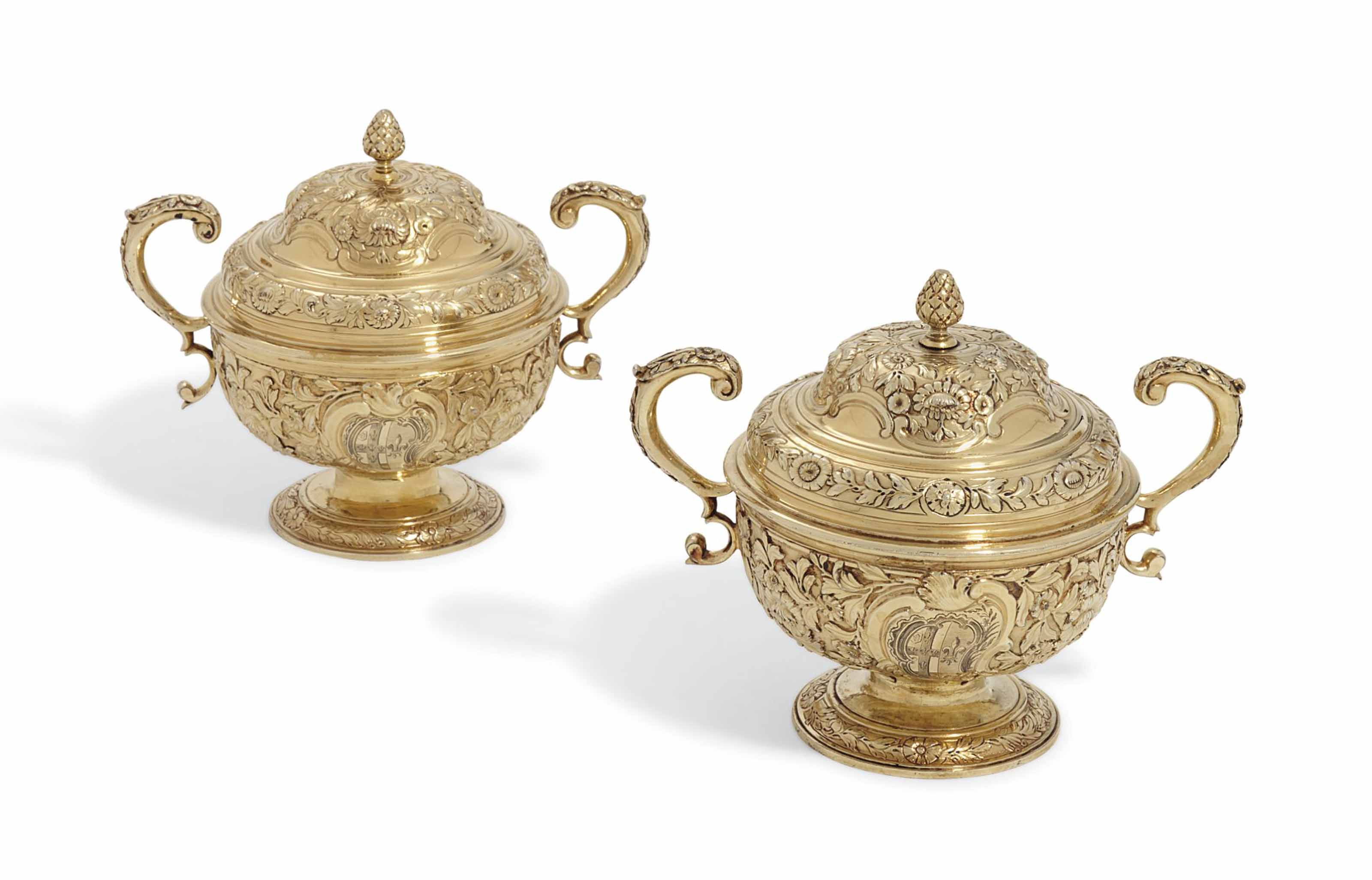 A PAIR OF GEORGE II SILVER-GILT CUPS AND COVERS