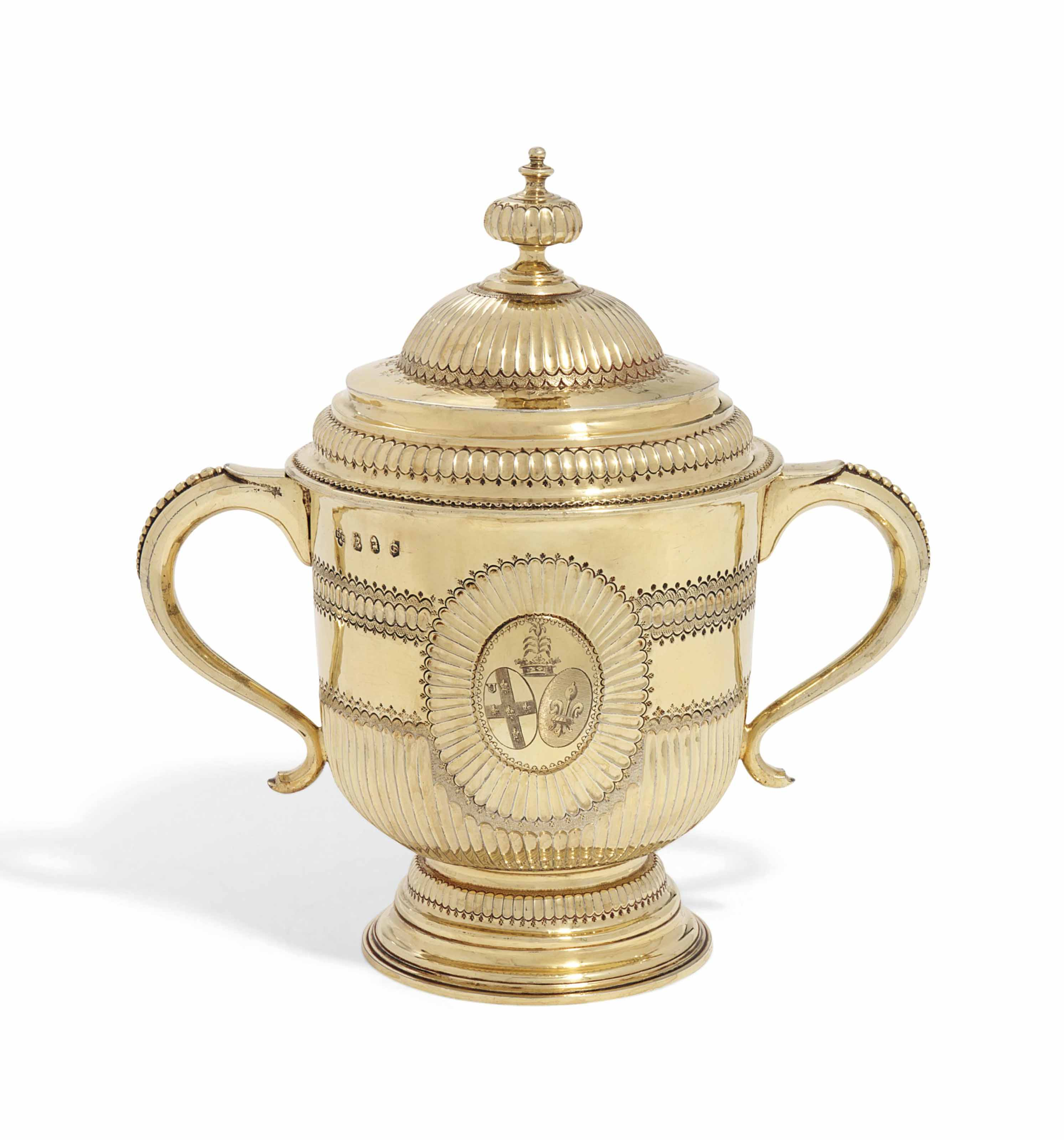 A QUEEN ANNE SILVER-GILT CUP AND COVER