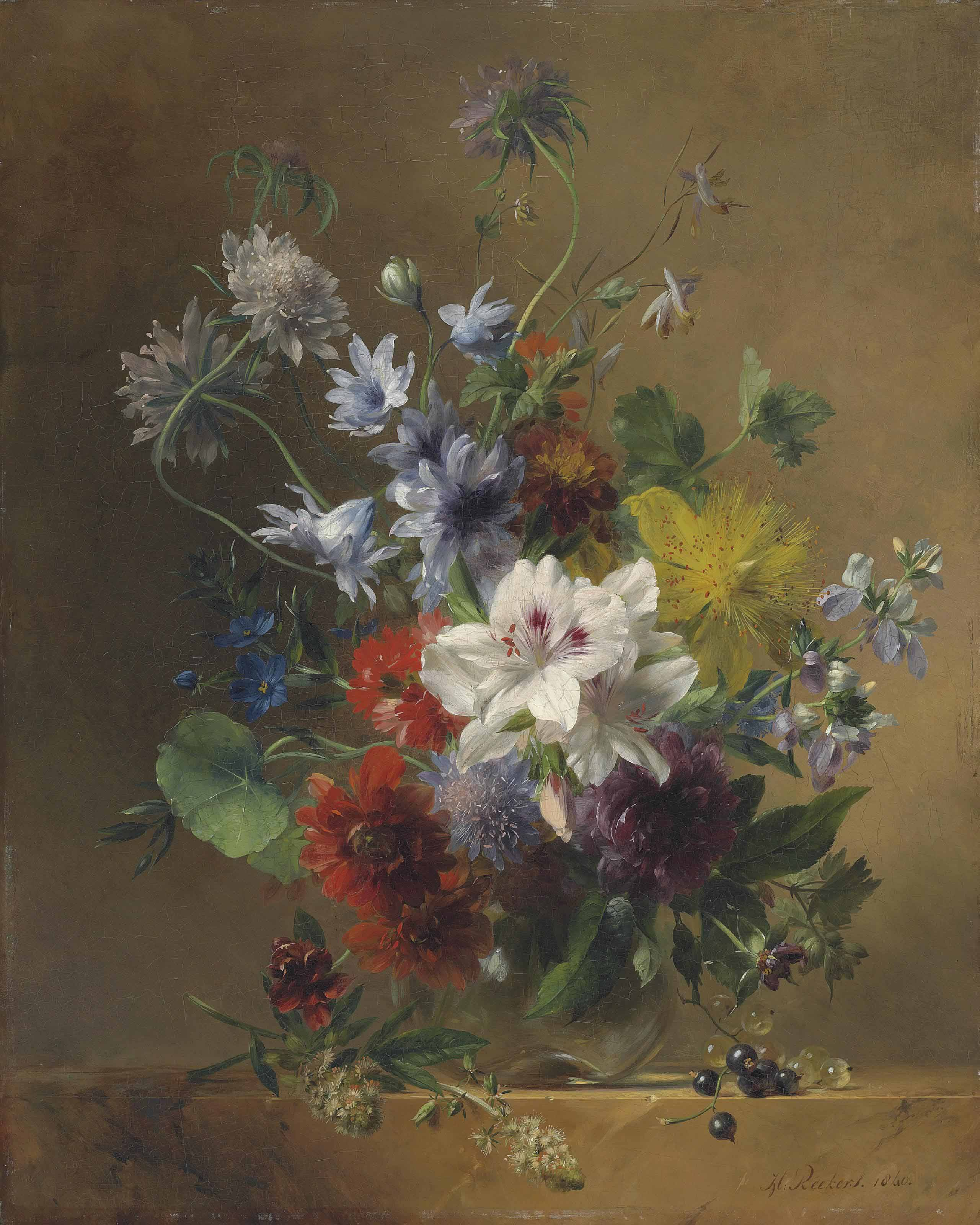 Summer flowers in a glass vase on a stone ledge