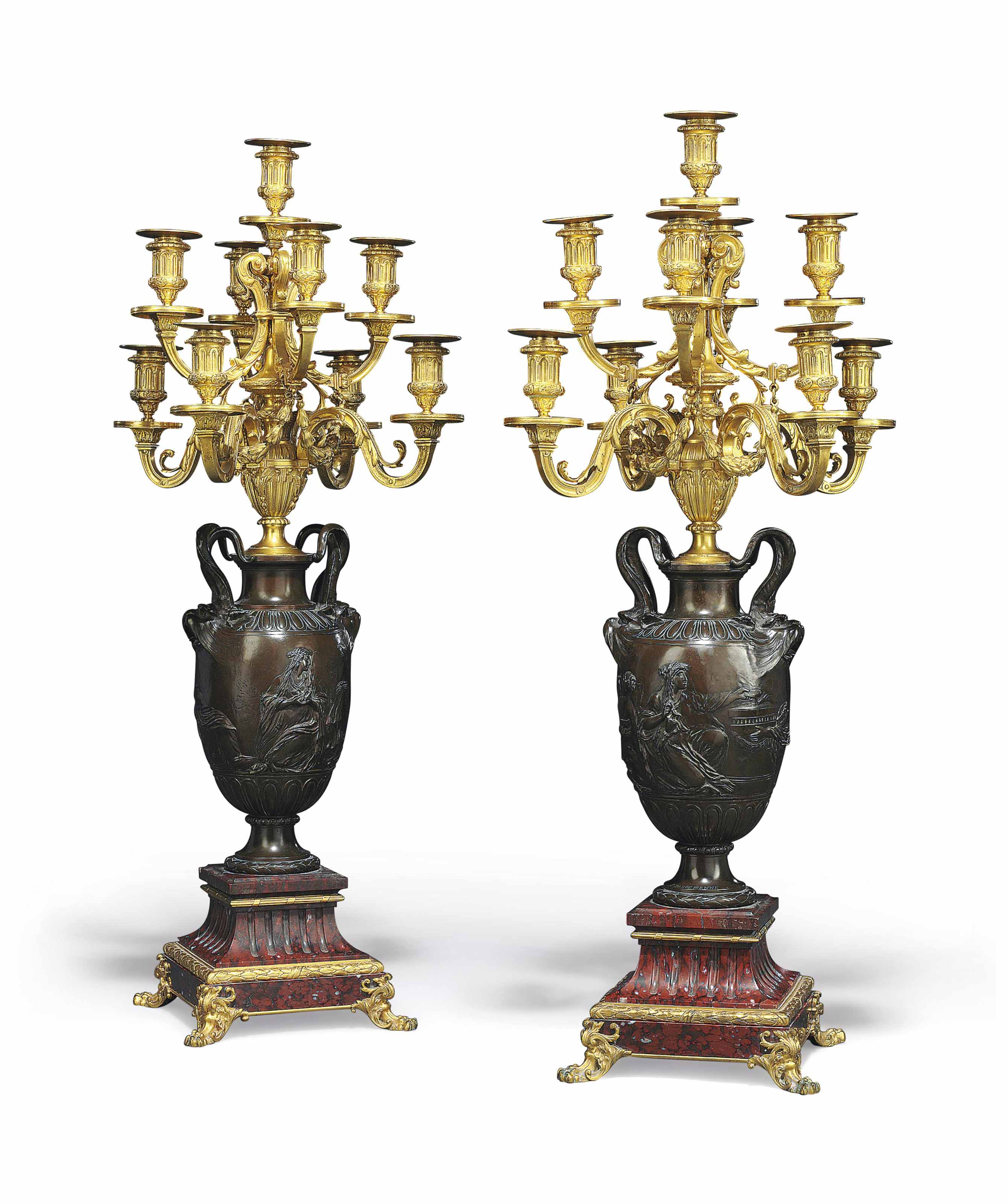 A PAIR OF FRENCH GILT AND PATINATED-BRONZE AND MARBLE NINE-LIGHT CANDELABRA