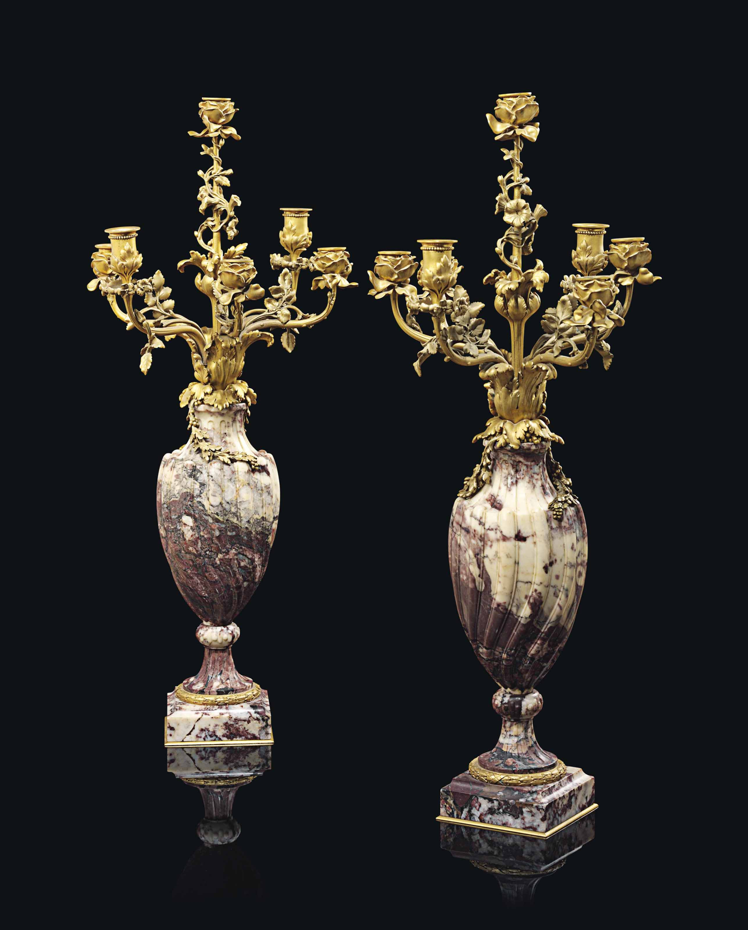 A PAIR OF FRENCH ORMOLU AND MARBLE SEVEN-LIGHT CANDELABRA