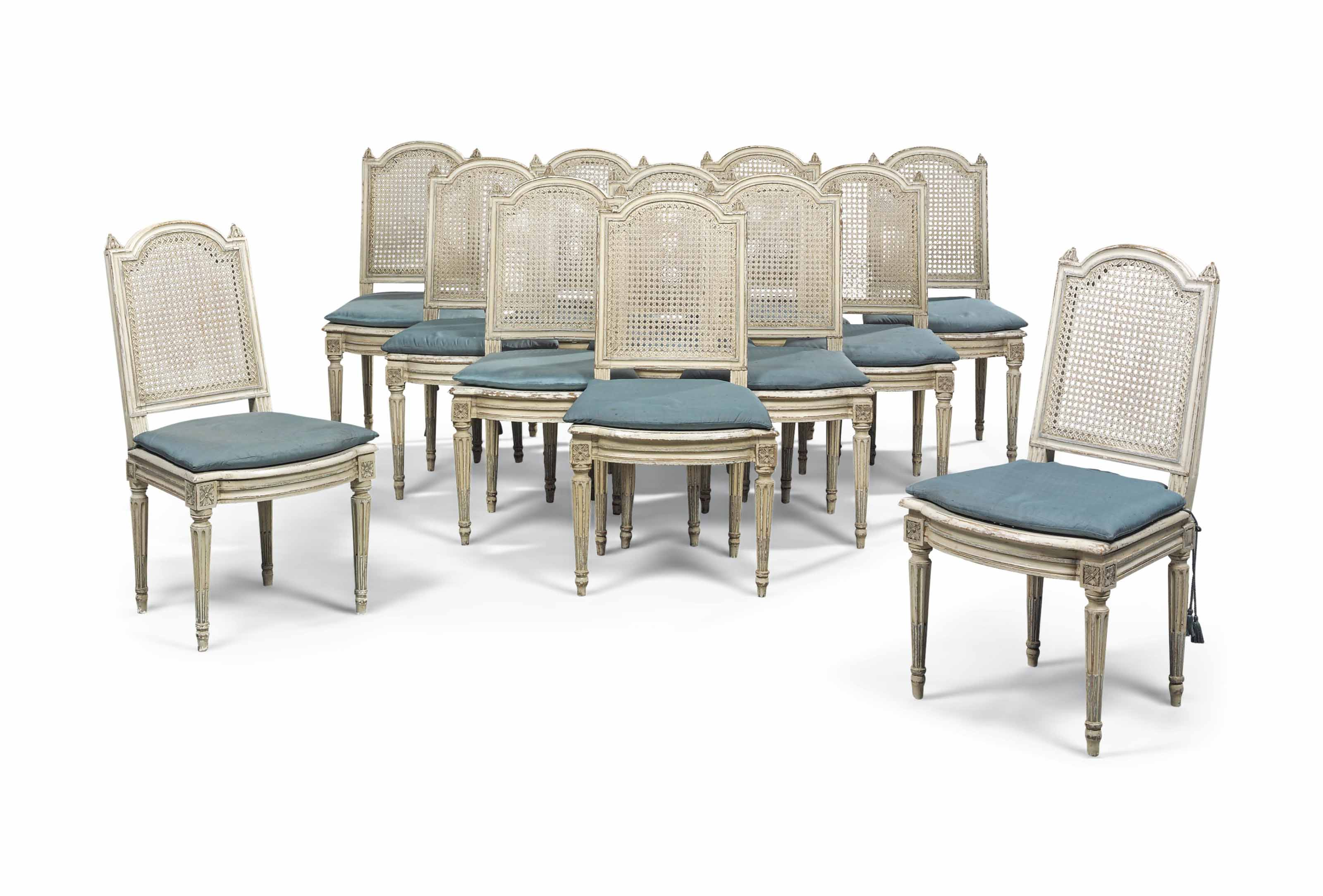 A SET OF TWELVE LOUIS XVI WHITE-PAINTED DINING CHAIRS