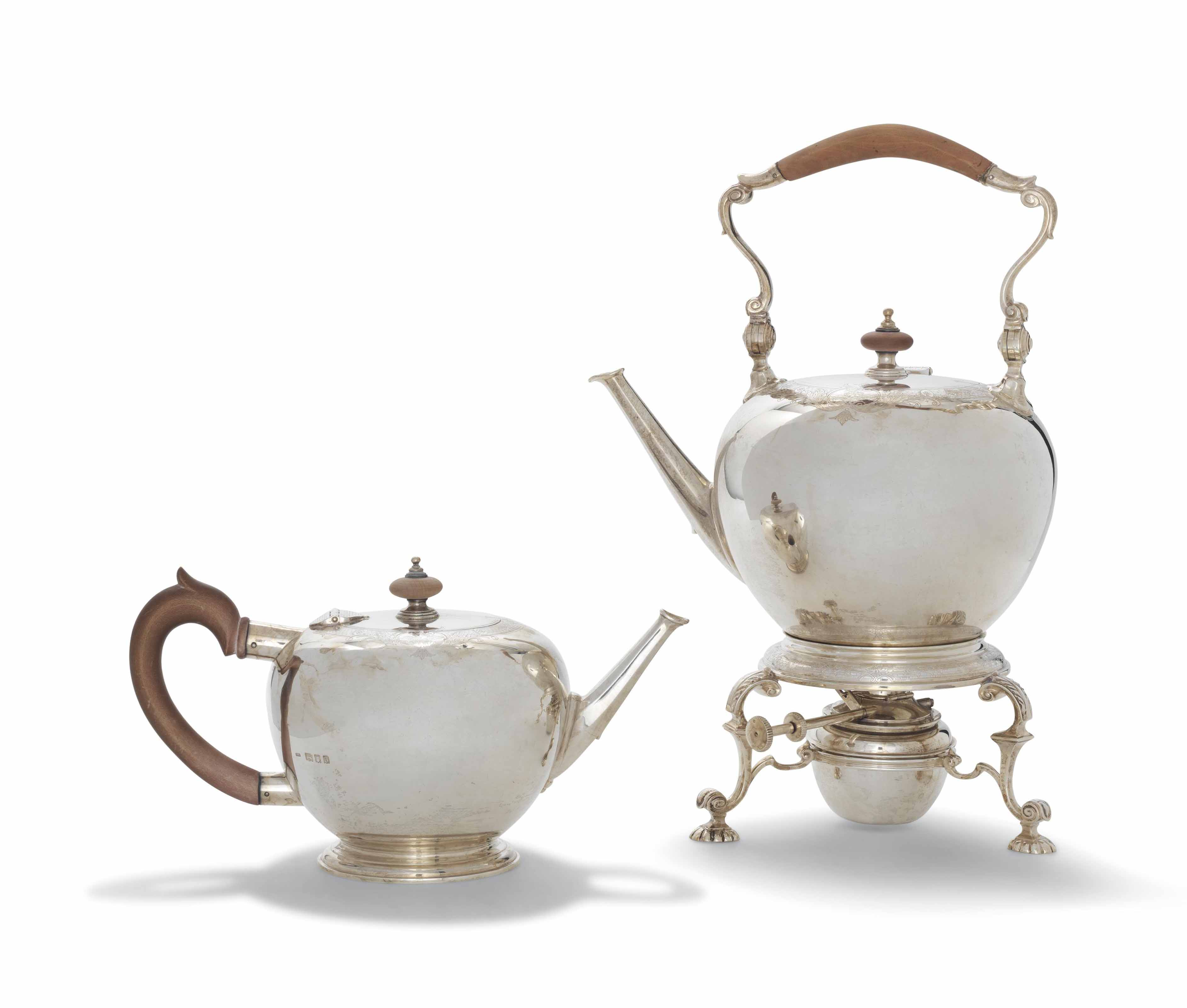 A GEORGE V SILVER KETTLE, STAND AND LAMP AND TEAPOT