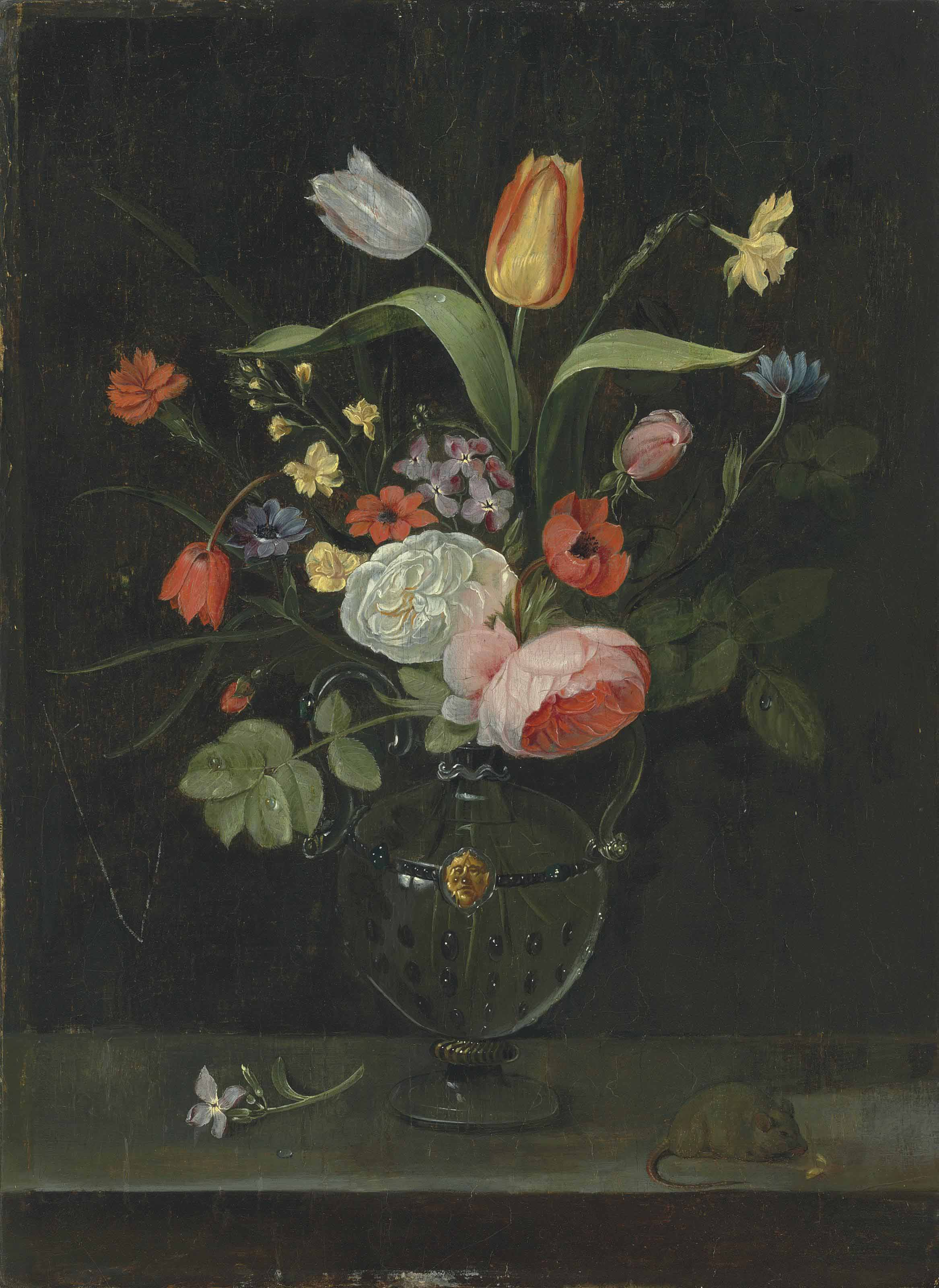 Roses, tulips, a daffodil and other flowers in a glass vase, on a stone ledge with a mouse