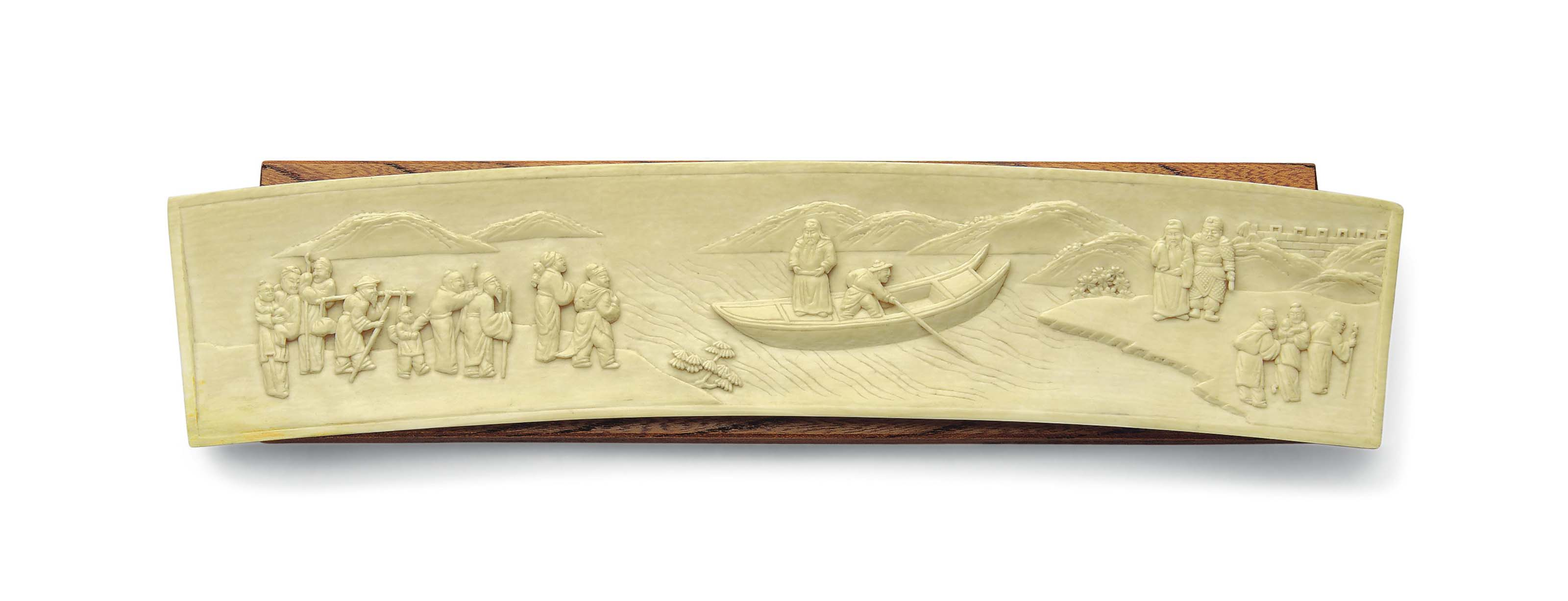 A CARVED IVORY WRIST REST