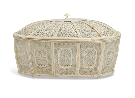 A PIERCED IVORY CASKET AND COV