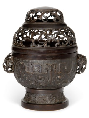 A BRONZE CENSER AND PIERCED CO
