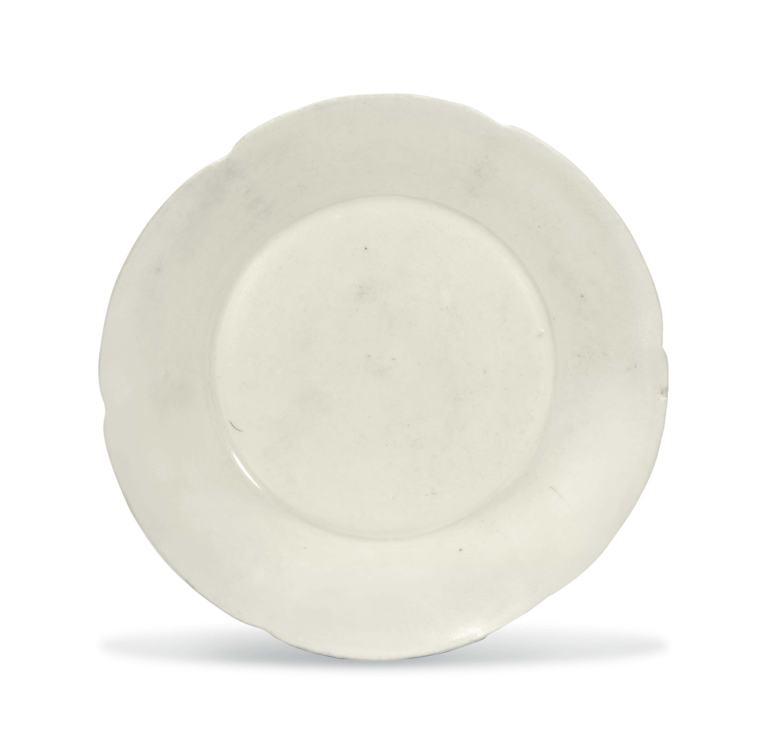 A SMALL DING MALLOW-FORM DISH