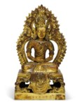 A GILT-BRONZE SEATED FIGURE OF