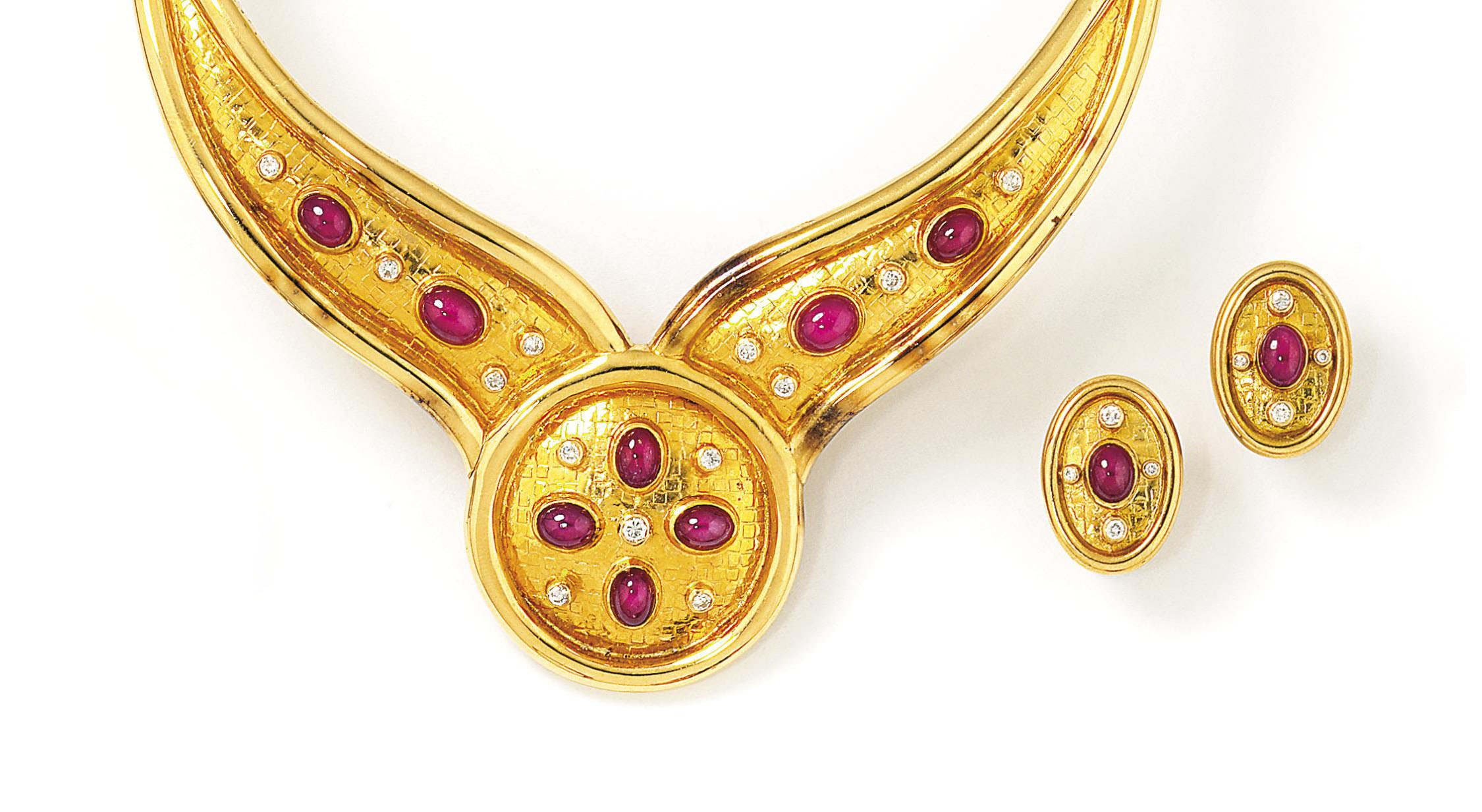 A ruby and diamond necklace and earring suite, by Lalaounis; and a necklace and bangle suite, by Zolotas
