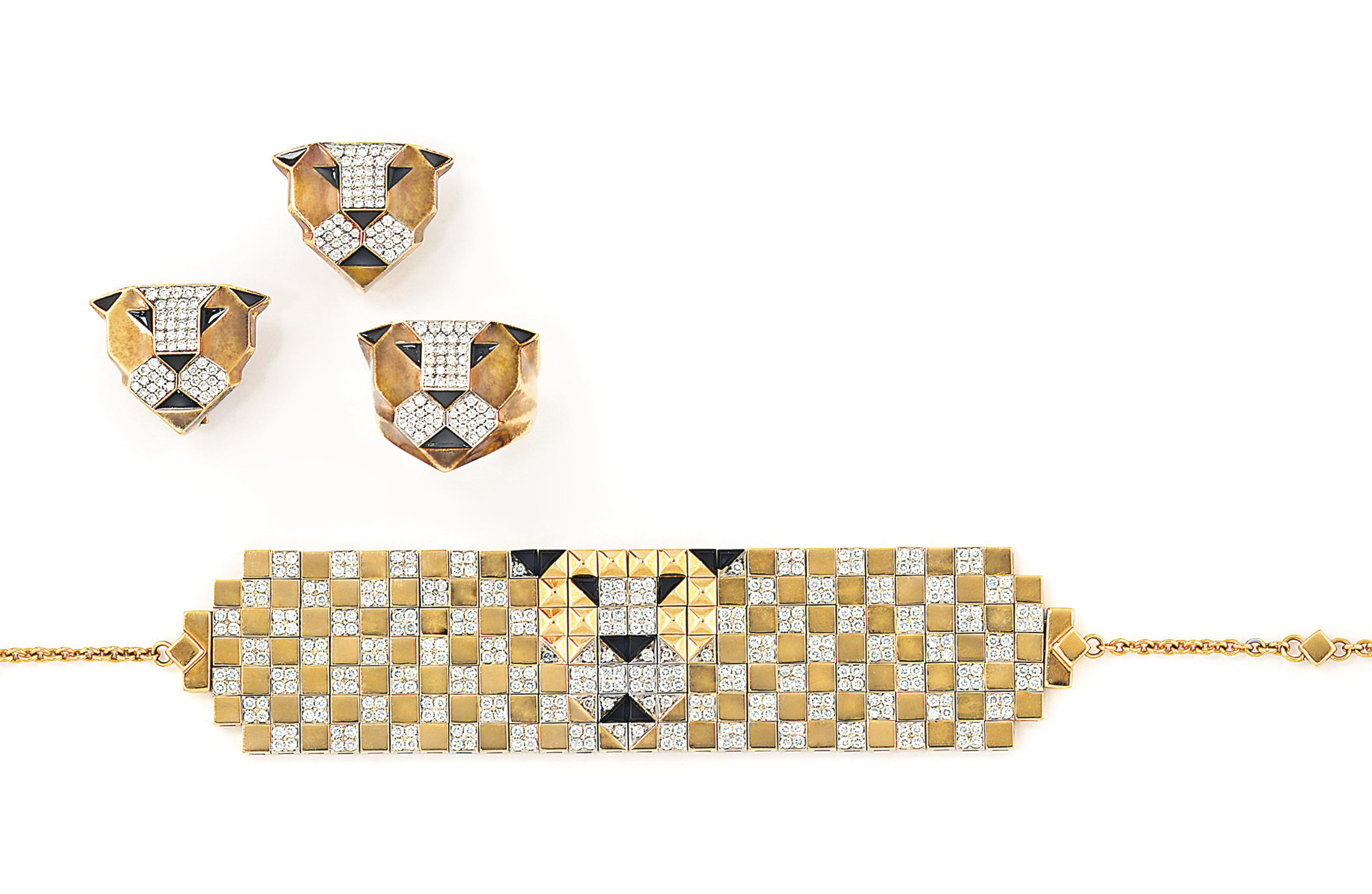 A diamond and gem-set 'Lion' ring, earring, bracelet and pendant suite, by Enigma