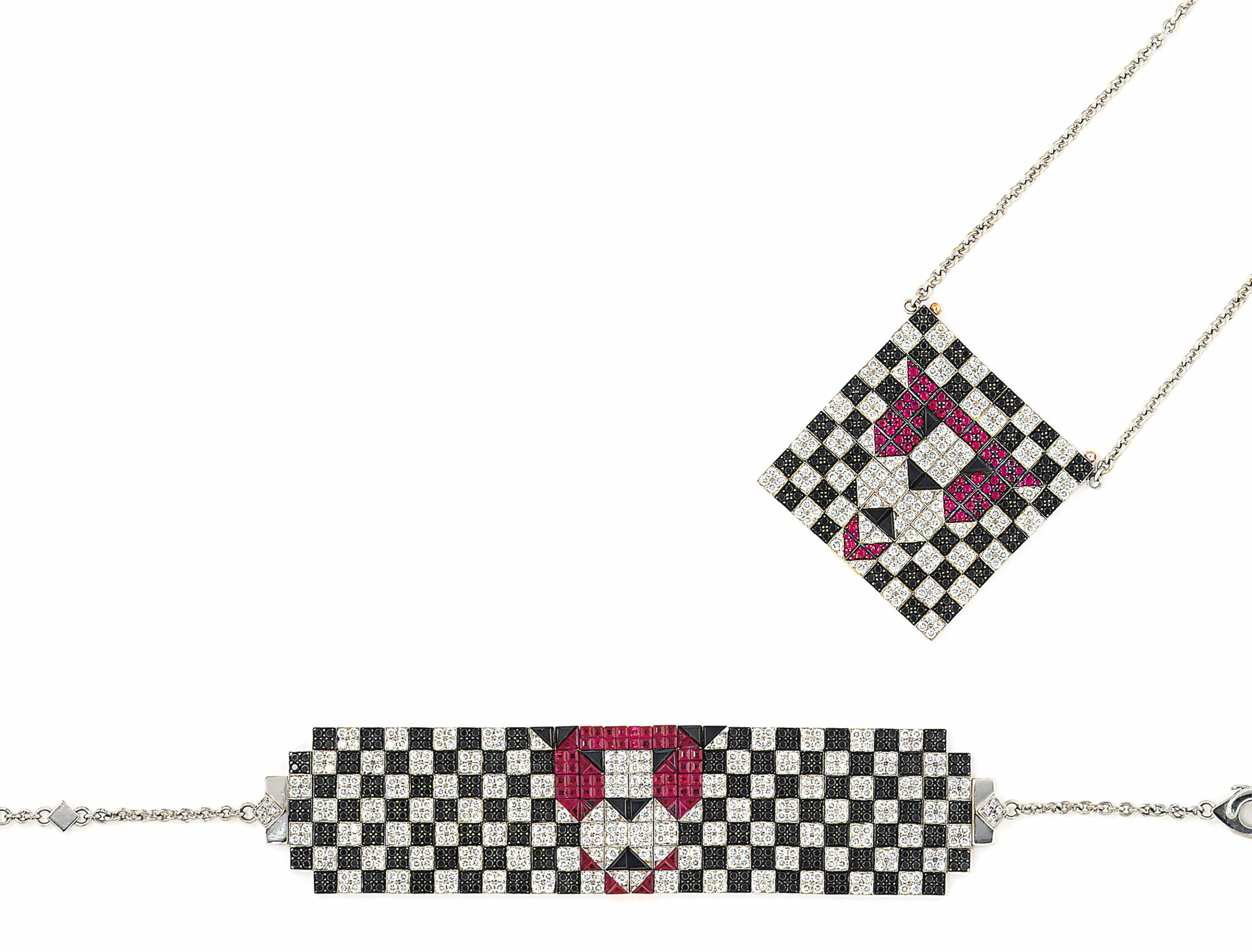 A RUBY AND DIAMOND-SET 'LION' BRACELET AND PENDANT SUITE, BY ENIGMA