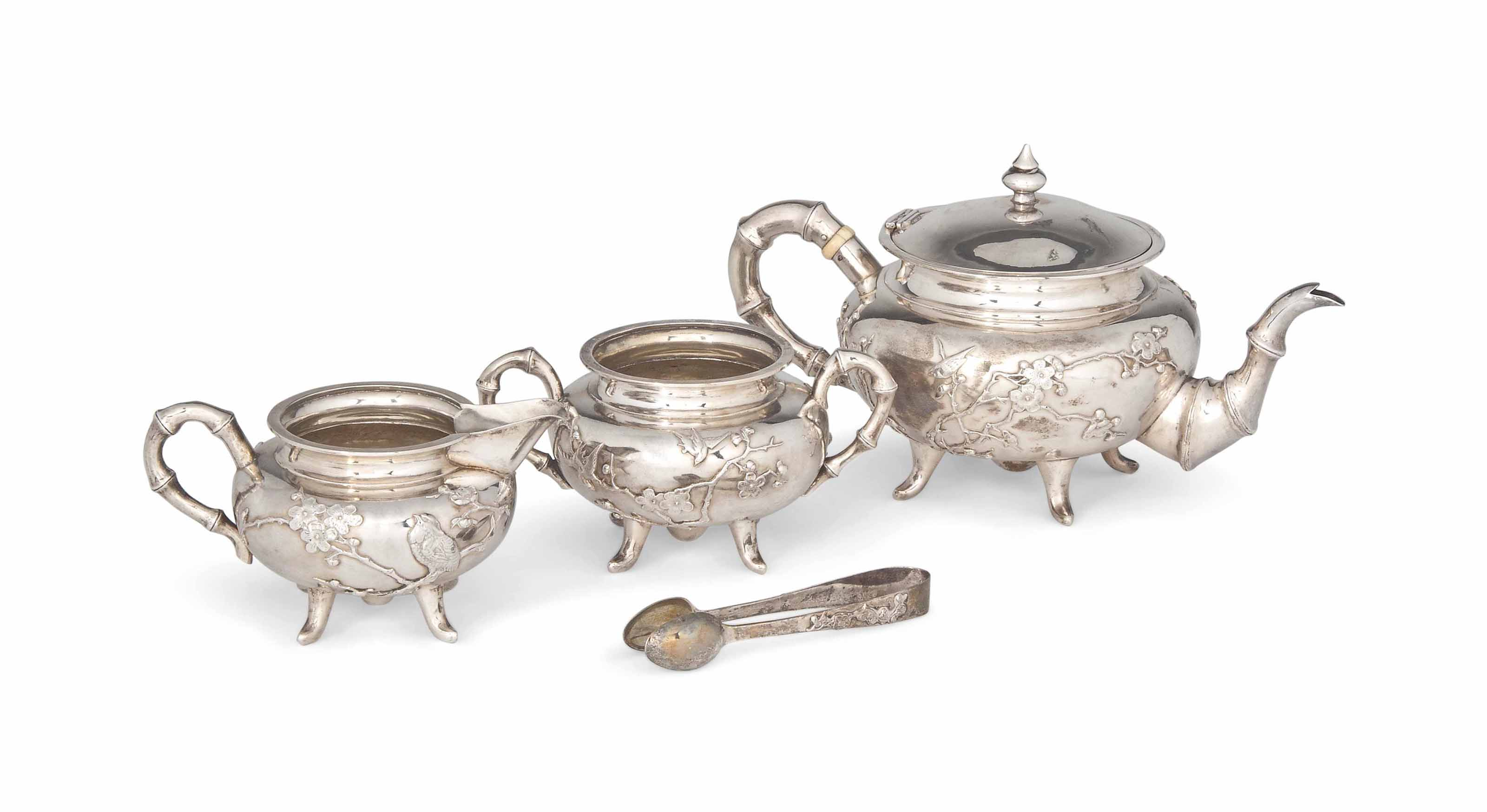 A CHINESE EXPORT SILVER THREE-PIECE TEA SET WITH ACCOMPANYING SUGAR TONGS