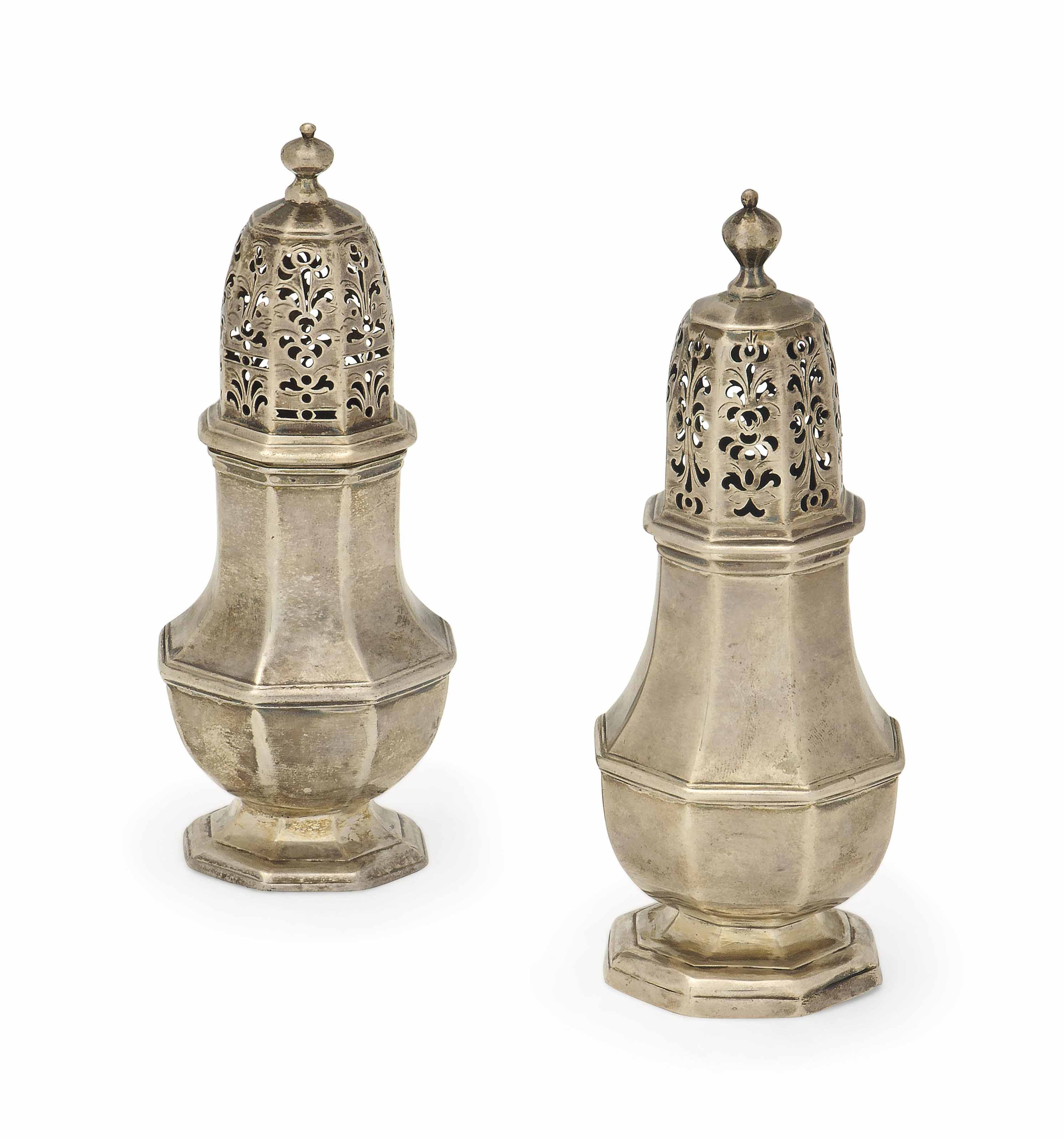 TWO VERY SIMILAR GEORGE I OCTAGONAL SILVER CASTERS