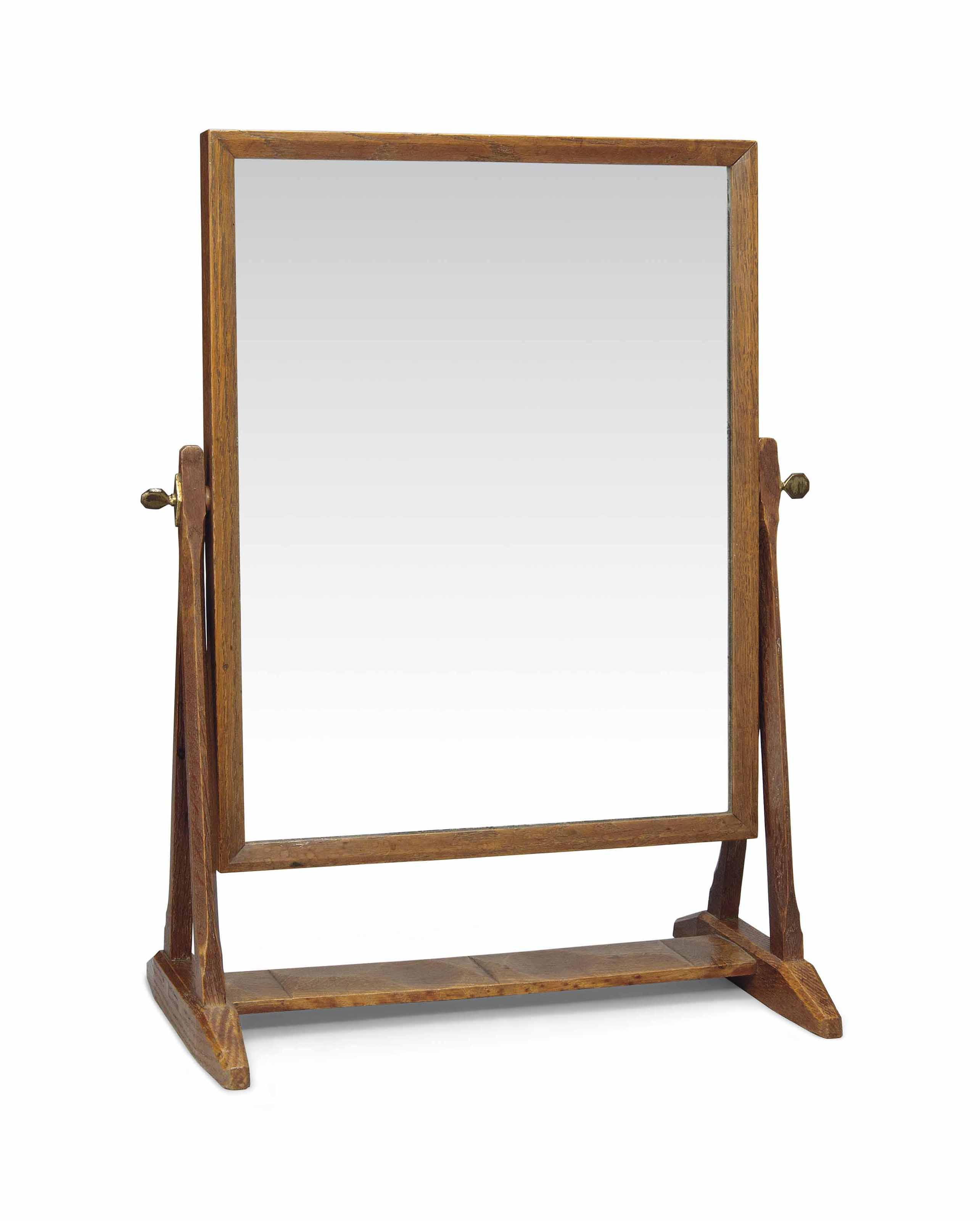 AN ARTS AND CRAFTS OAK DRESSING TABLE MIRROR