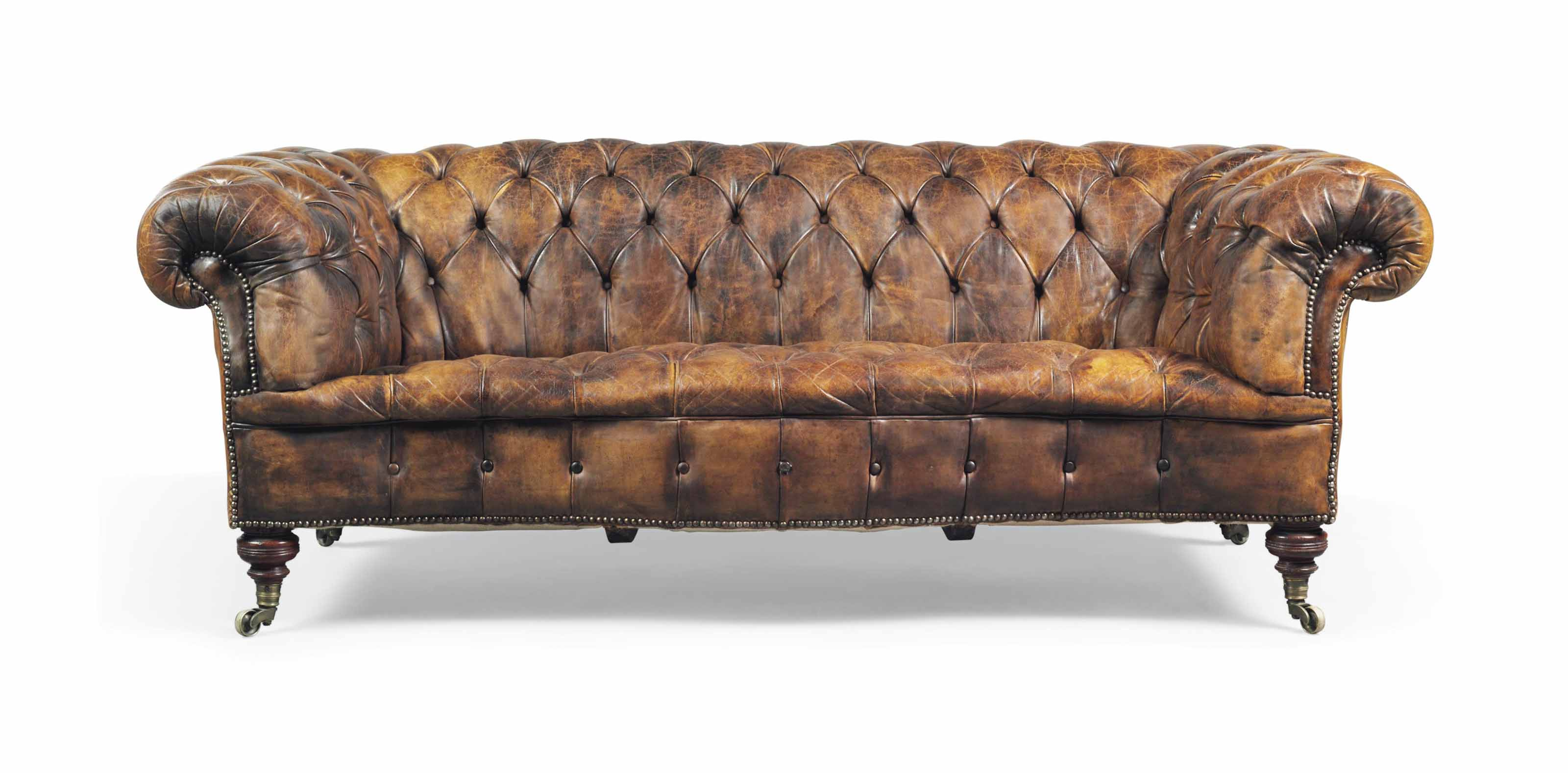 A VICTORIAN WALNUT SERPENTINE CHESTERFIELD SOFA