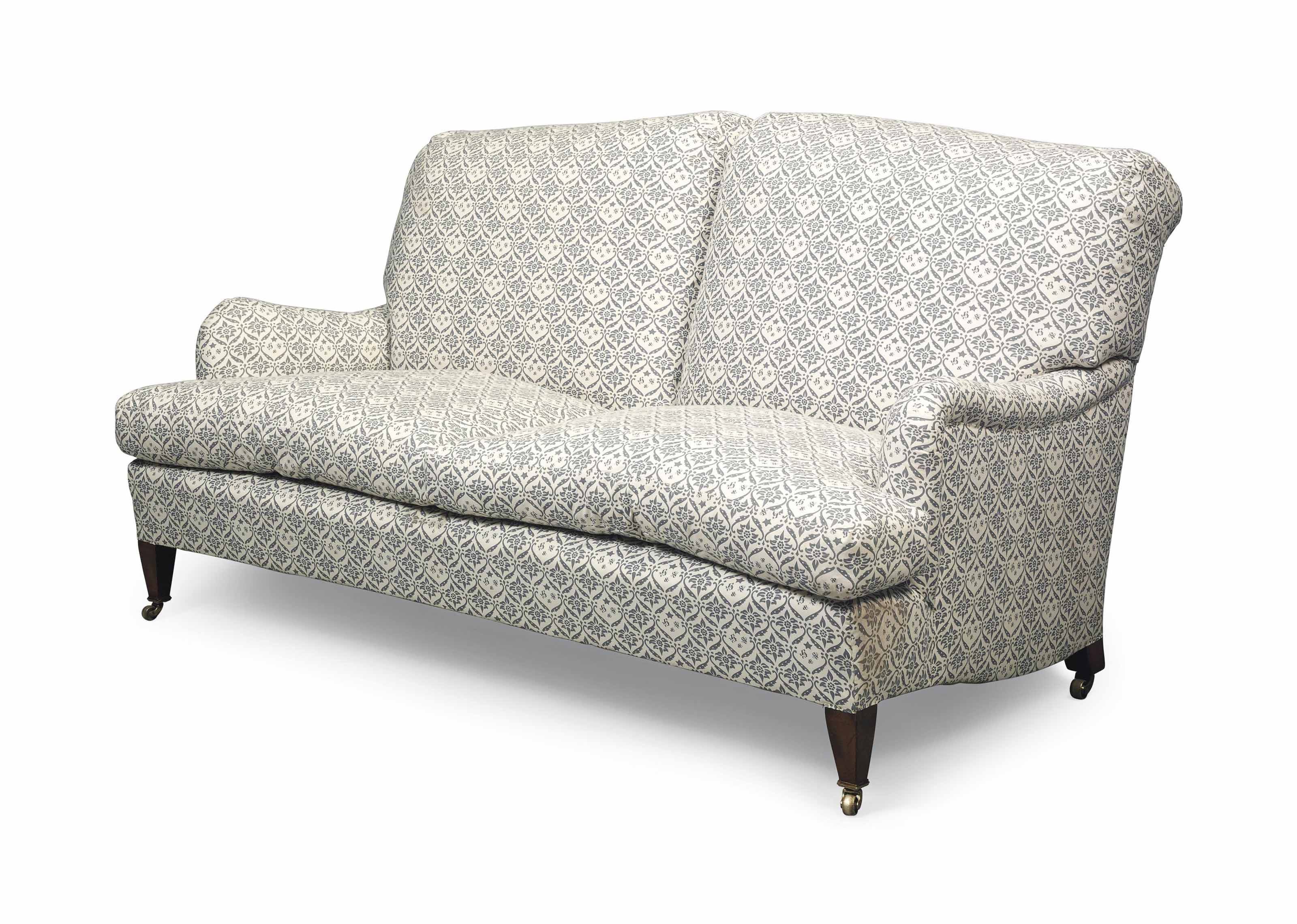 A BEECH TWO-SEATER SOFA