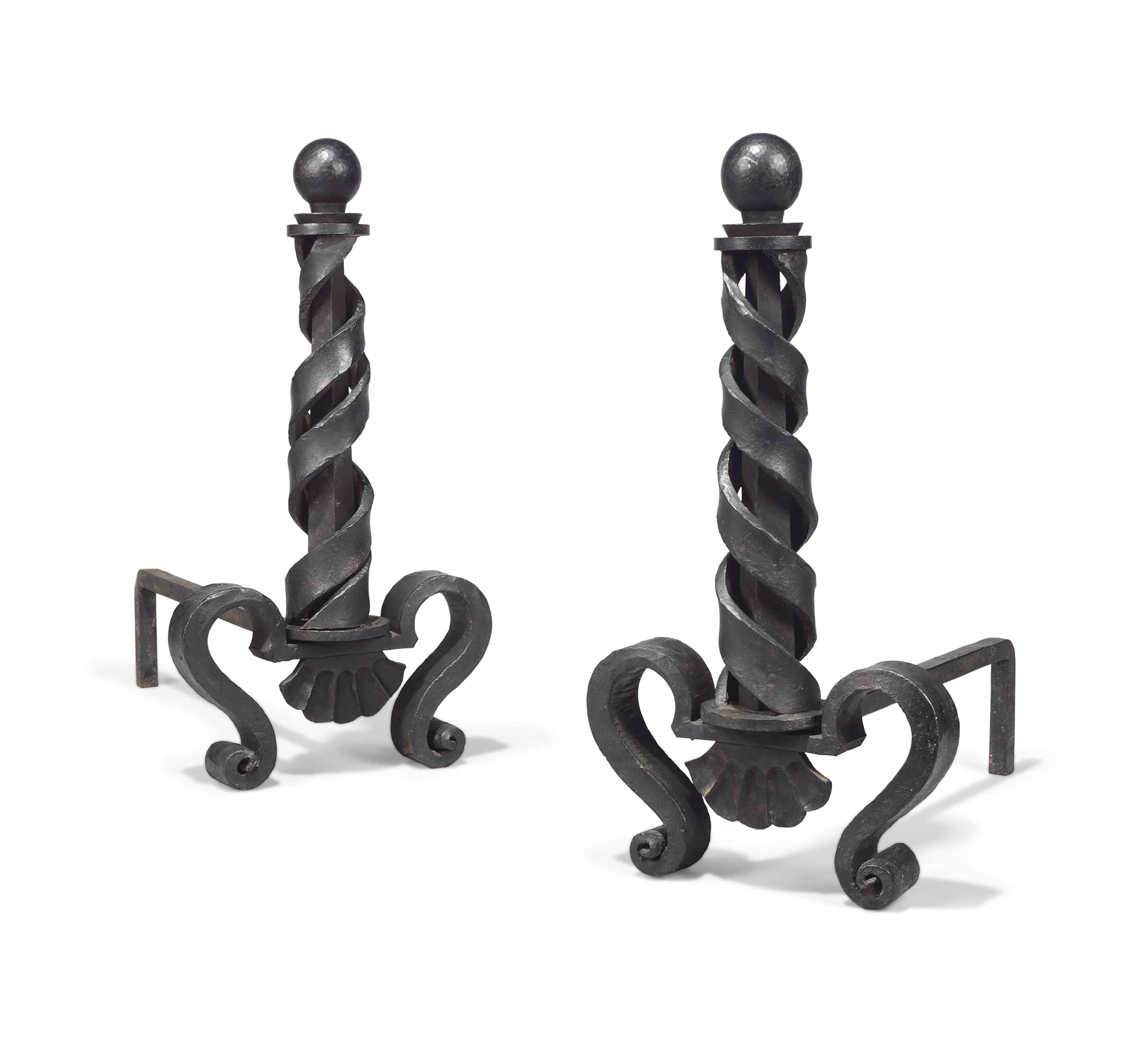 A PAIR OF RAYMOND SUBES (1893-1970) CAST AND WROUGHT IRON ANDIRONS